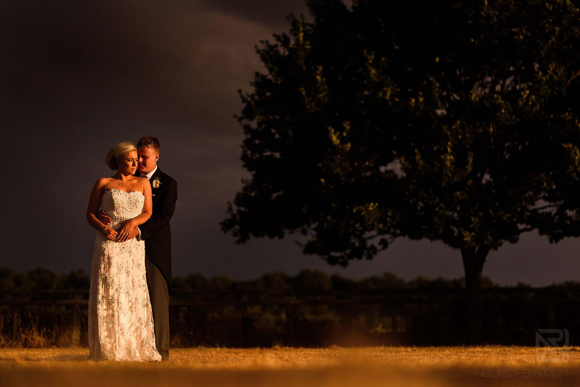 portrait of bride and groom in during summer storm