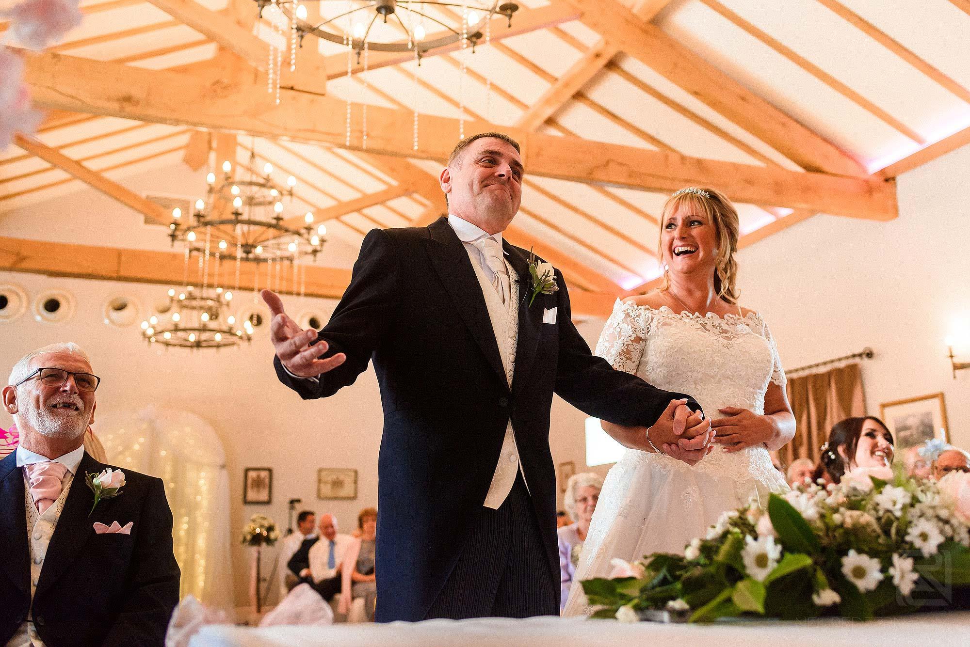 happy groom during wedding service