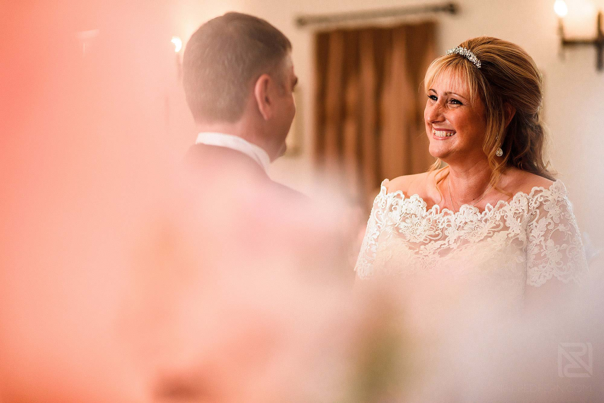 bride and groom looking at each other during wedding ceremony at The Villa Wrea Green