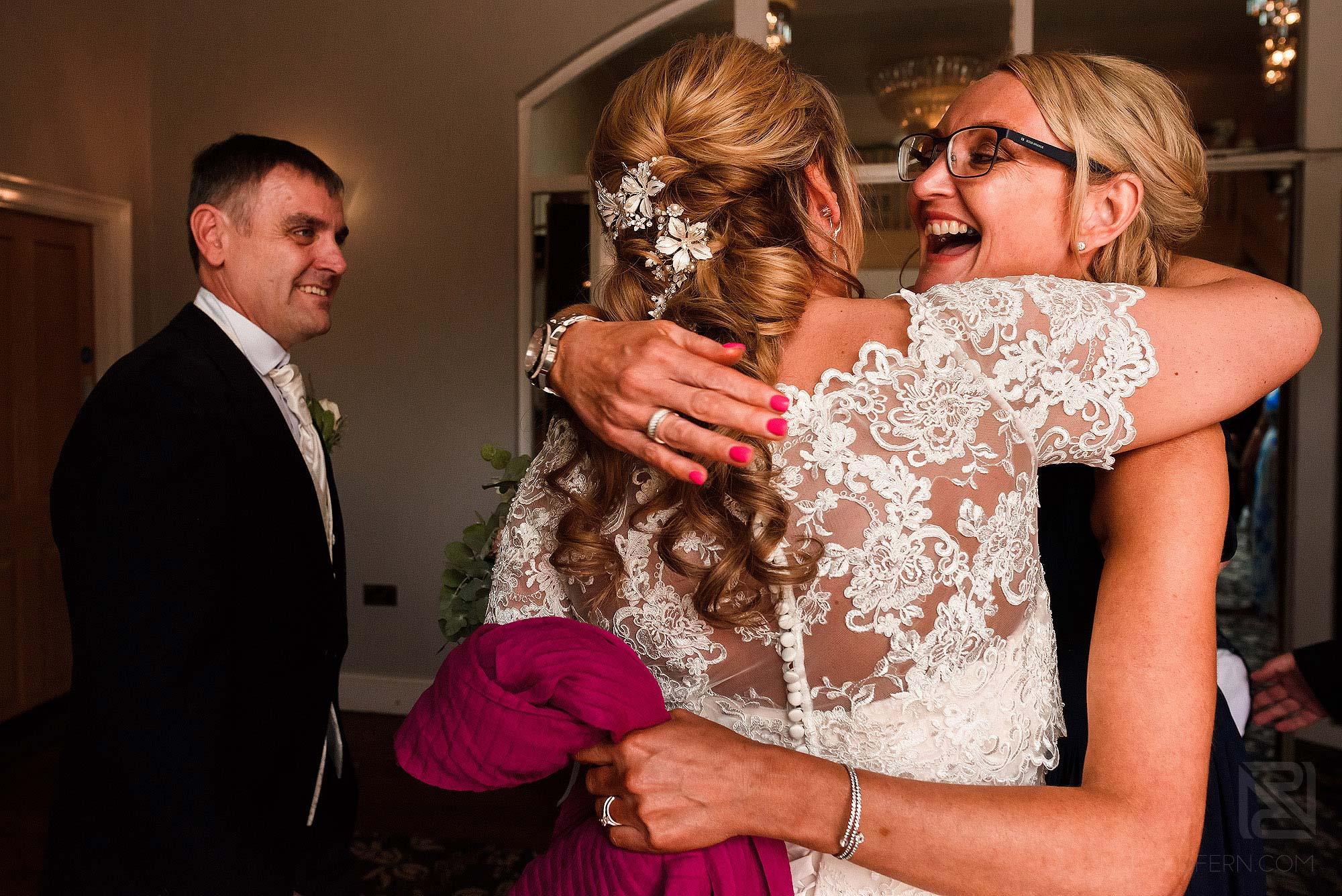 friend congratulating bride after wedding ceremony