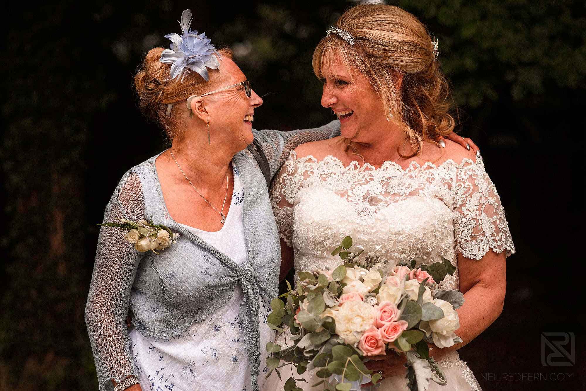 bride and best friend smiling at each other