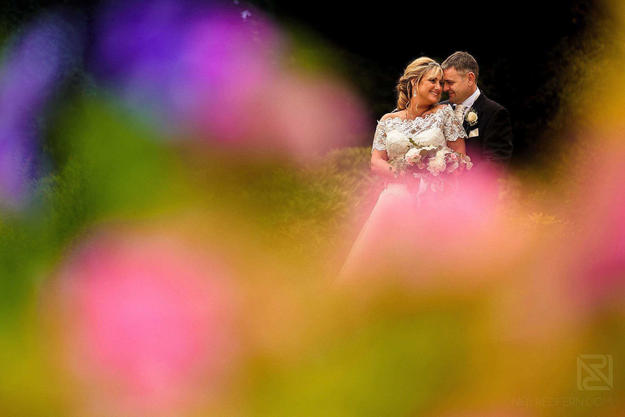 colourful portrait of bride and groom at The Villa Wrea Green in Lancashire