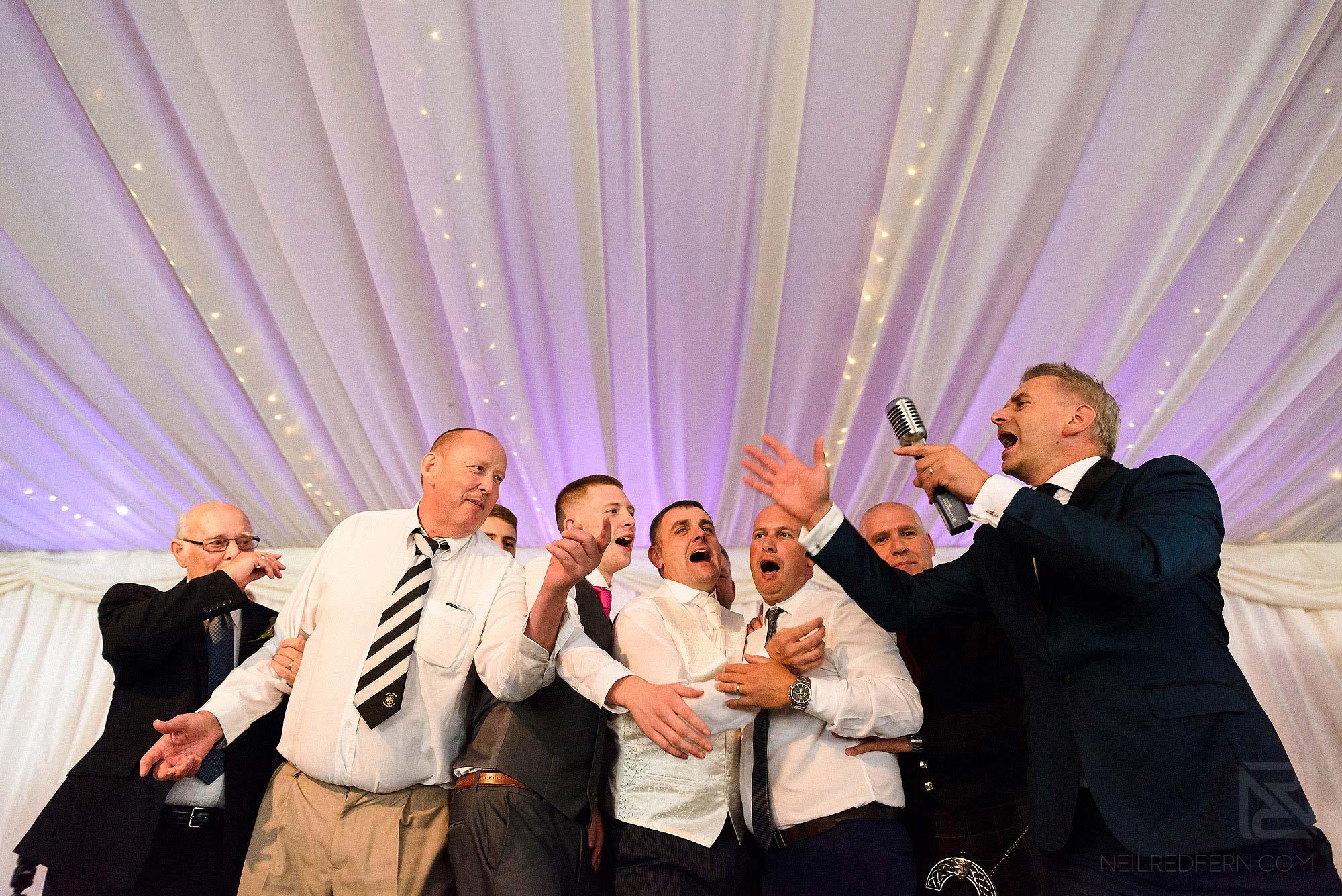Paul Guard singing at wedding