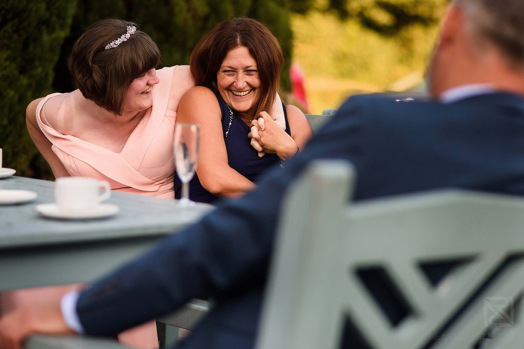 wedding guests smiling and laughing
