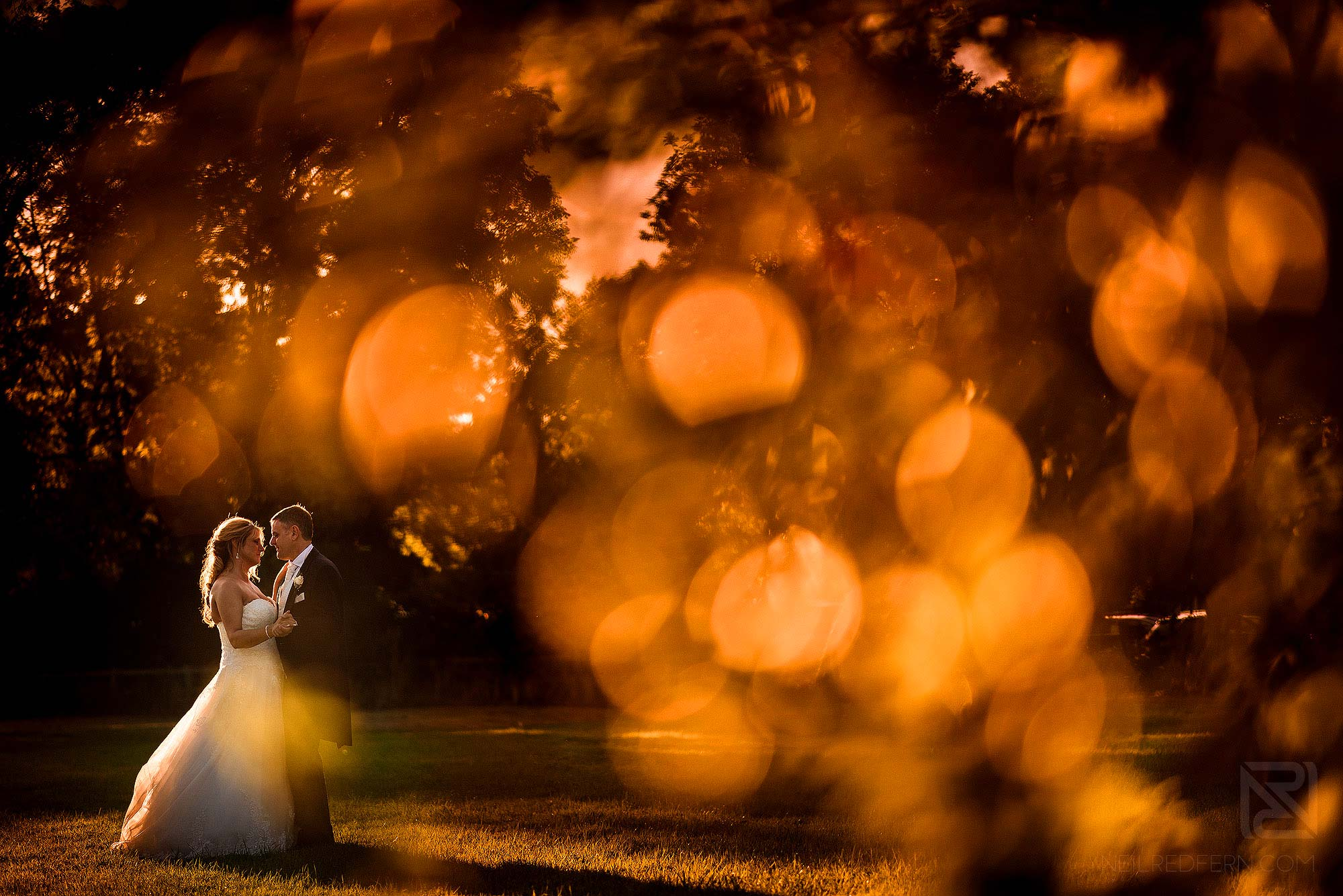 golden hour portrait of newlyweds at The Villa Wrea Green in Lancashire