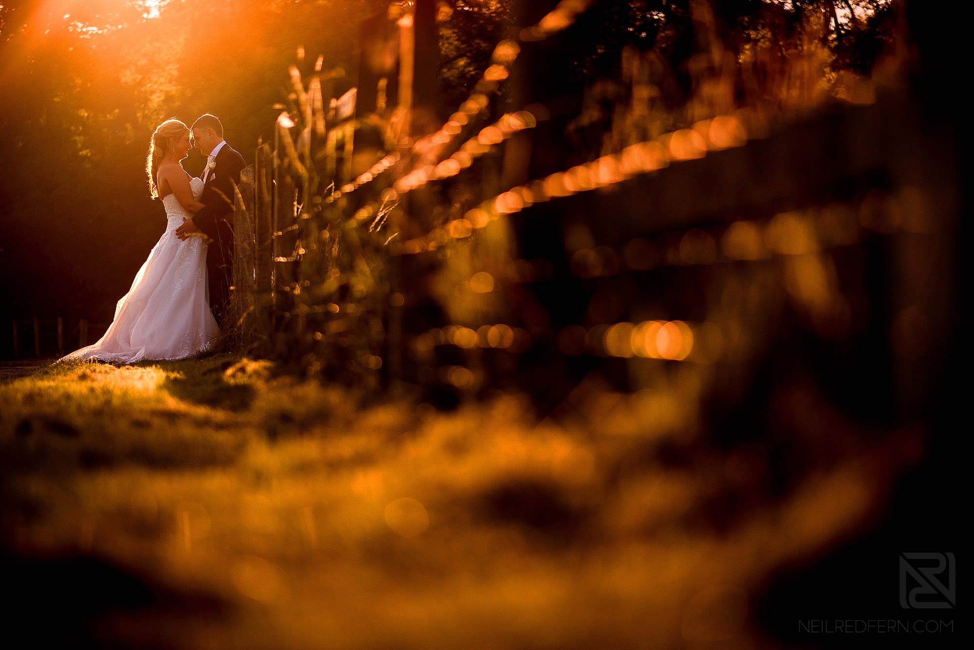 beautiful sunset photograph of bride and groom at The Villa Wrea Green