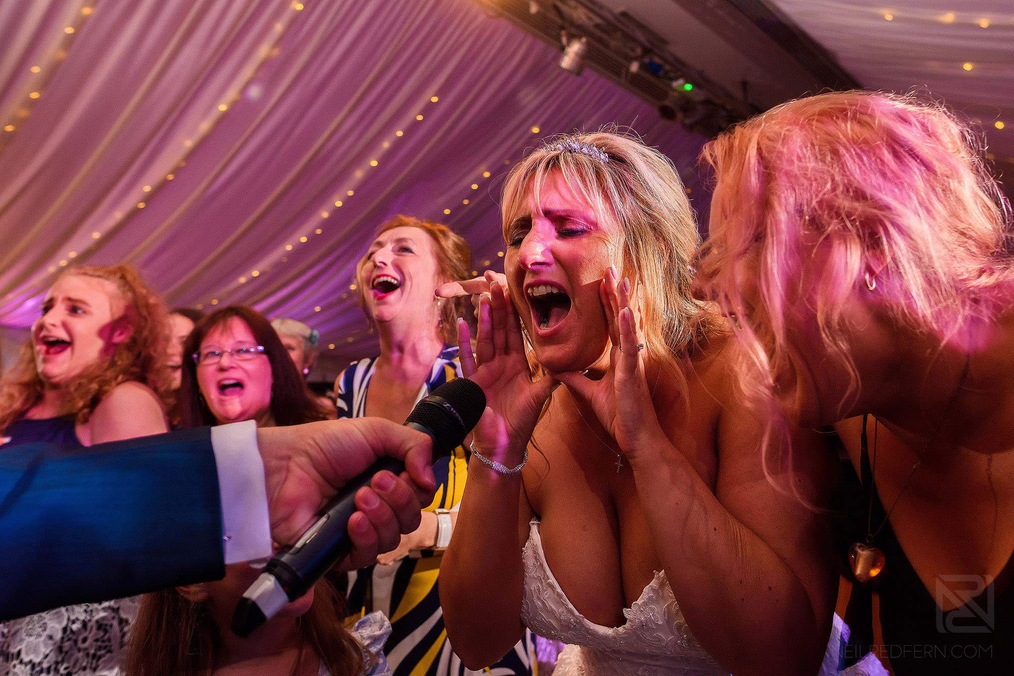 bride singing in to microphone