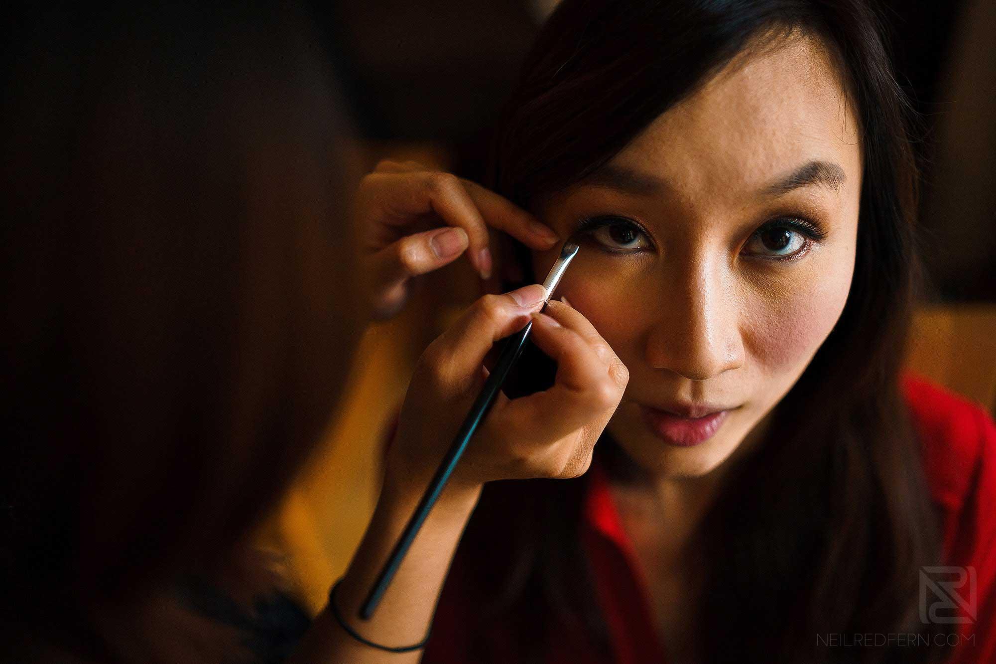 chinese bride having make-up put on