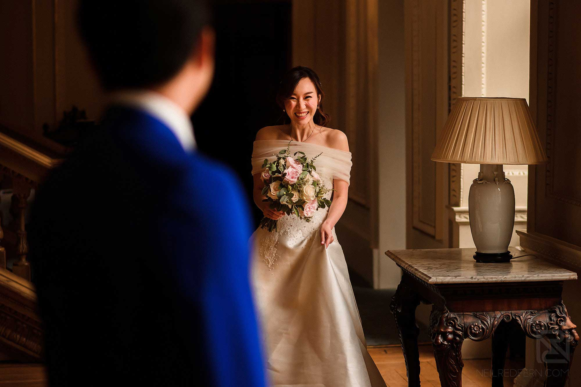 happy bride looking at groom for first time