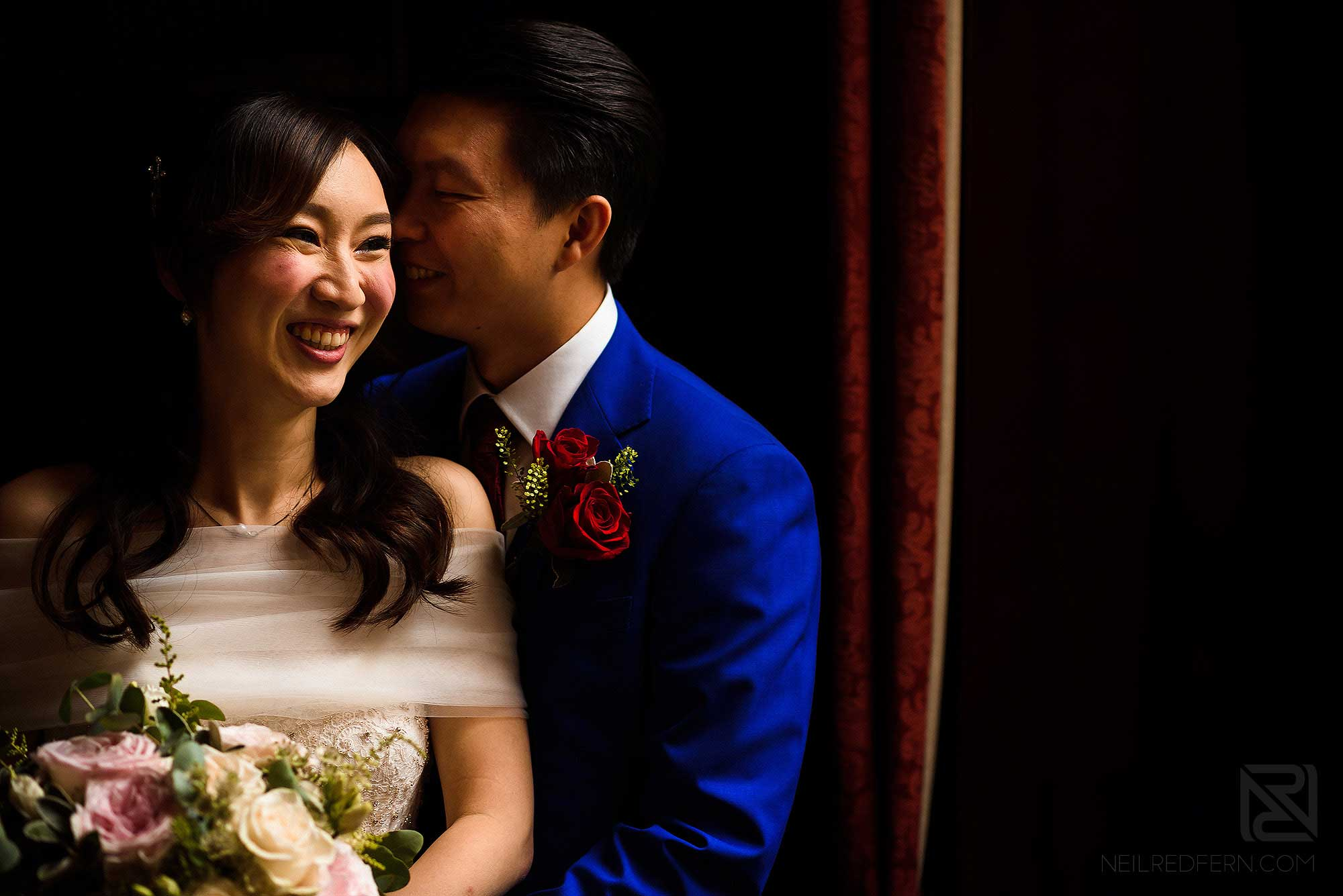 close up photograph of bride and groom together