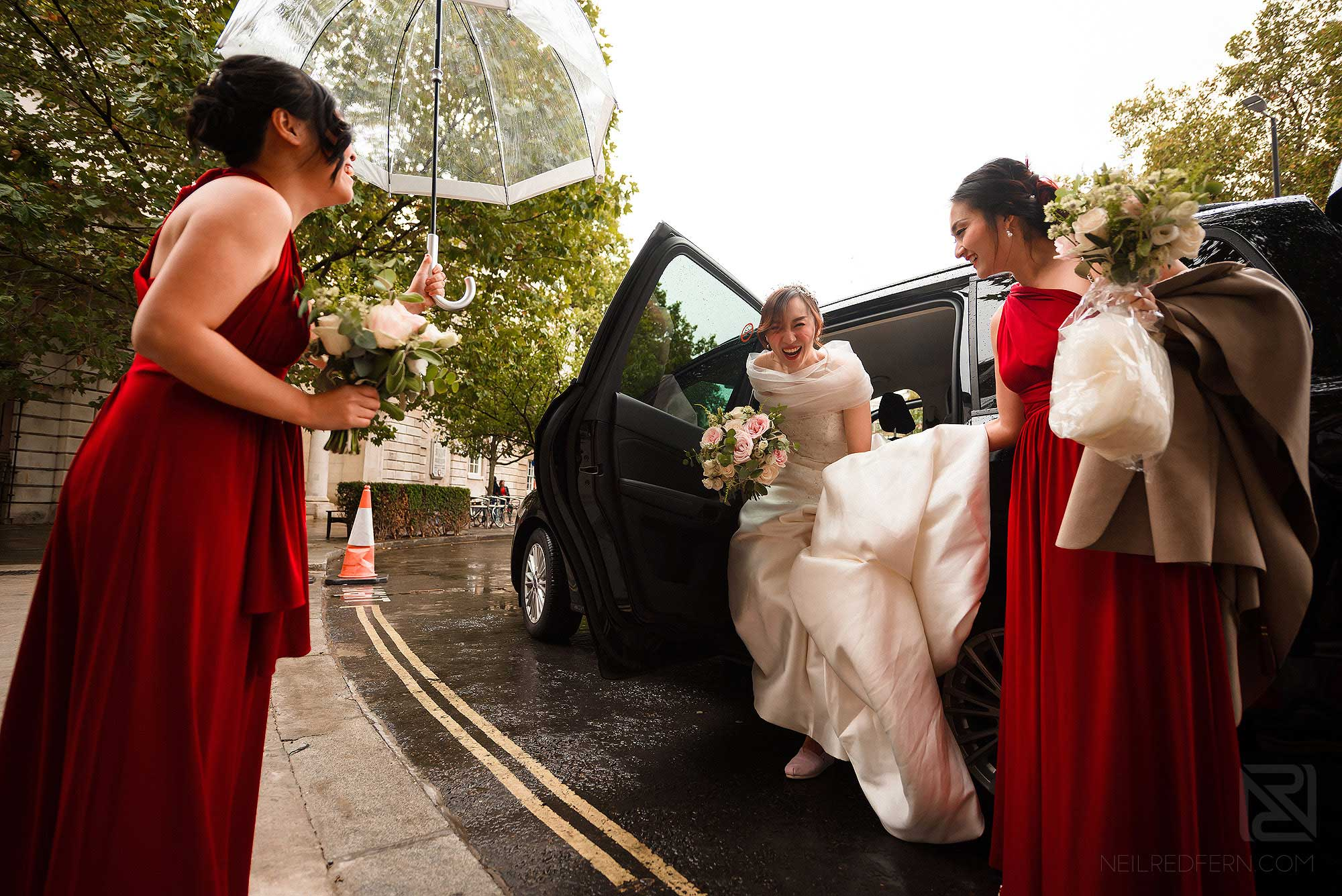 bride getting out of wedding car at St Barts church in London