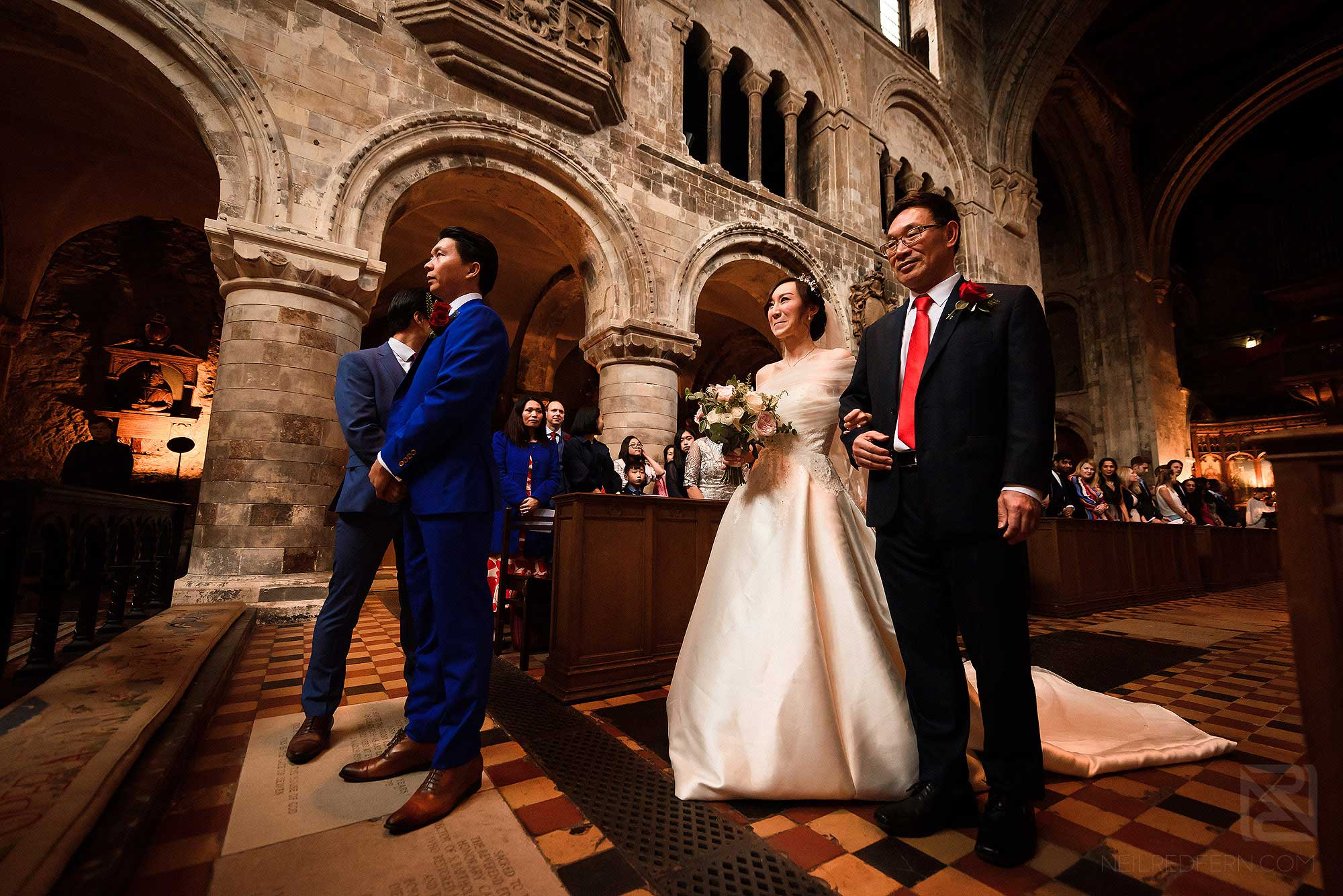 bride walking down the aisle at St Bartholomew the Great in London