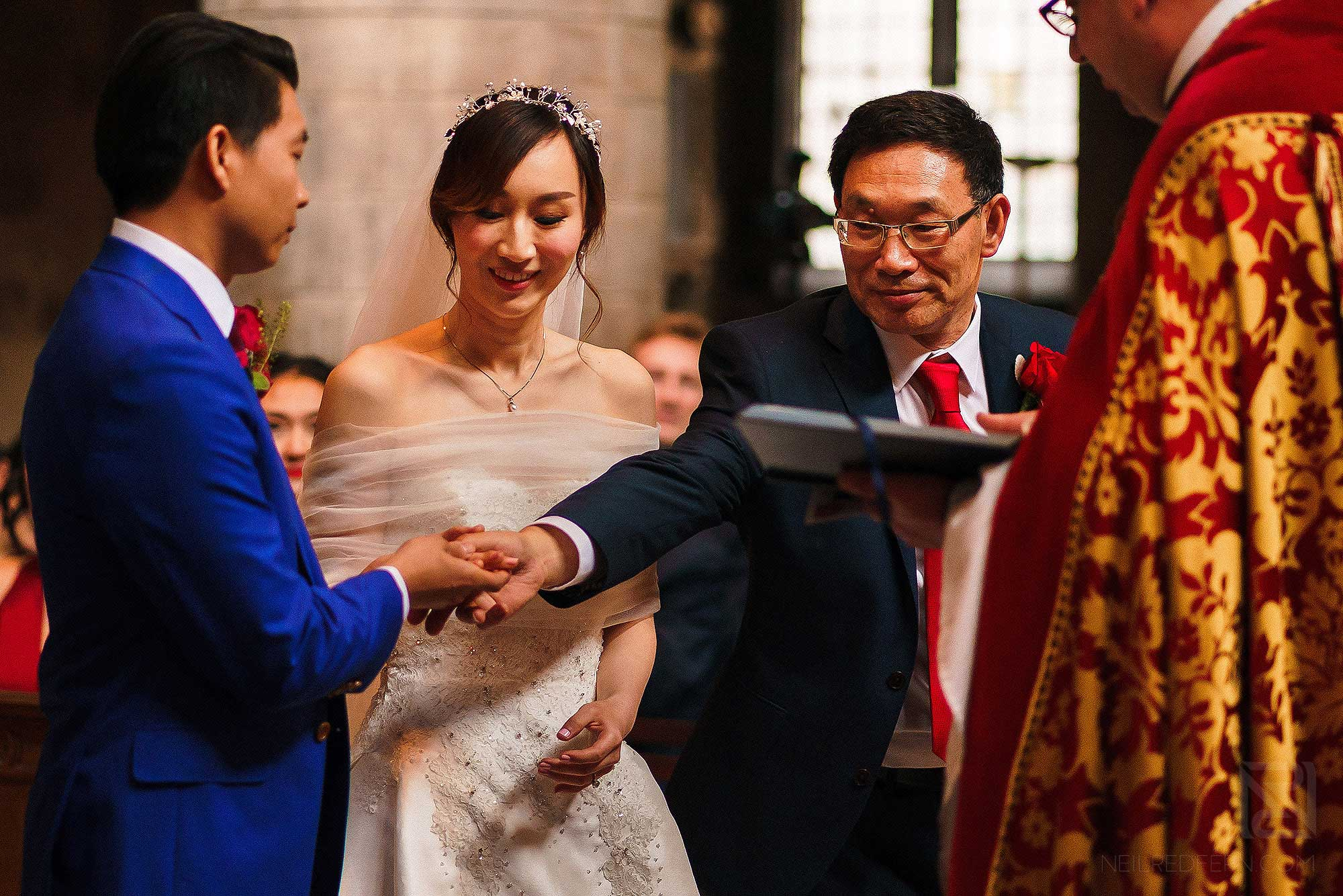 bride's father handing over daughter's hand
