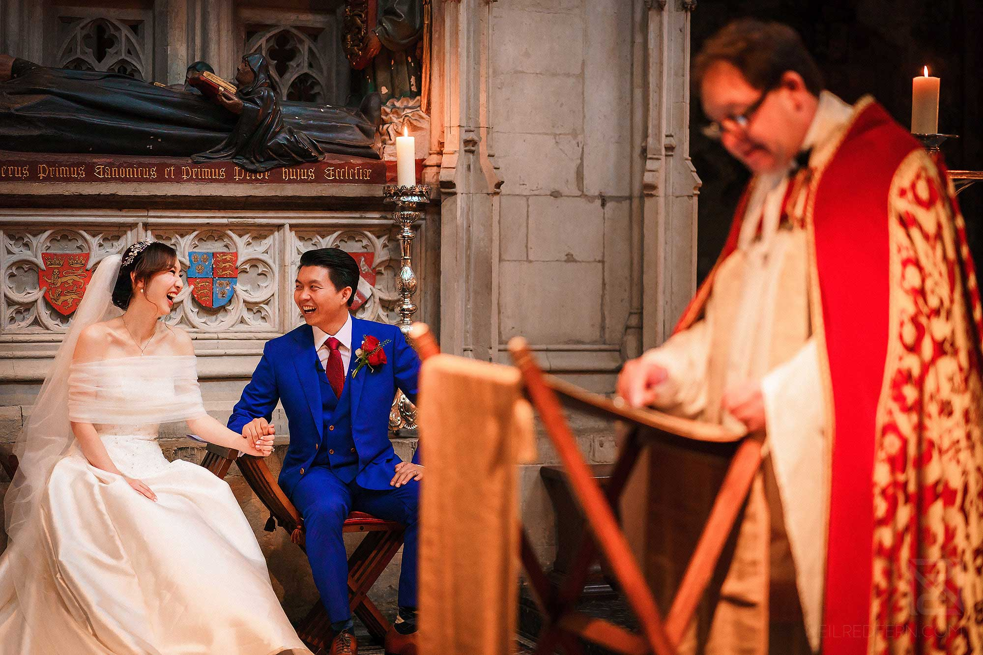bride and groom laughing together during wedding ceremony