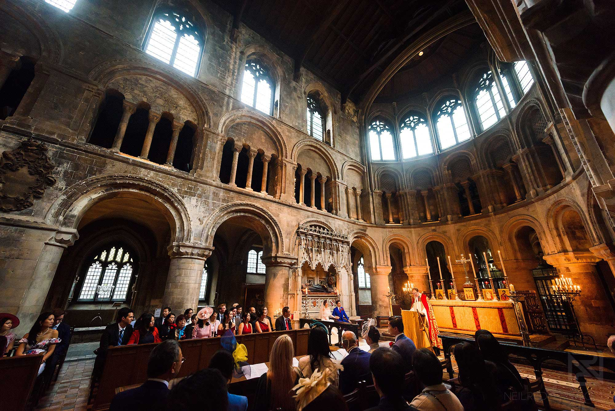 wide angle shot of wedding at St Bartholomew the Great in London