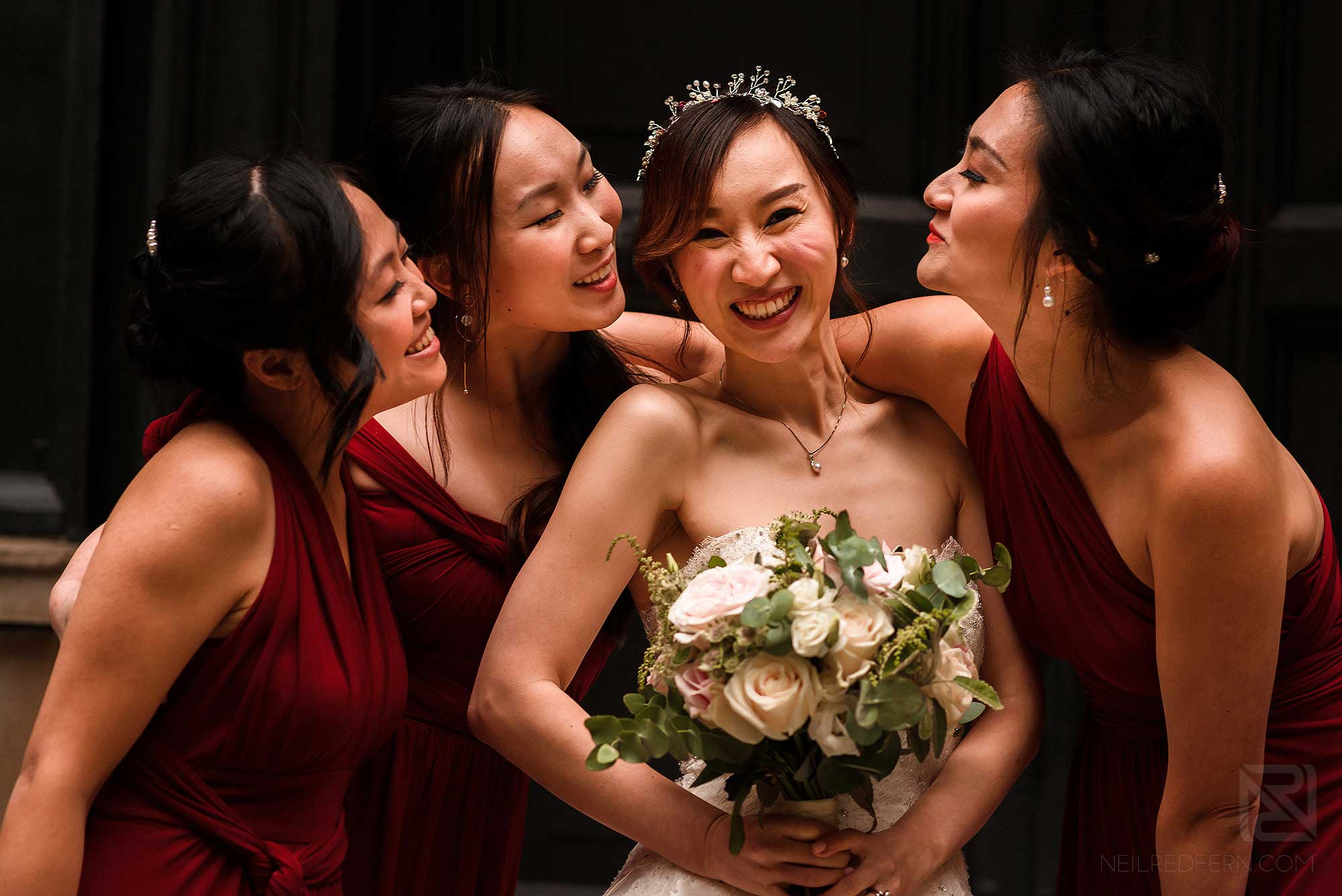 happy bride with bridesmaids in group shot