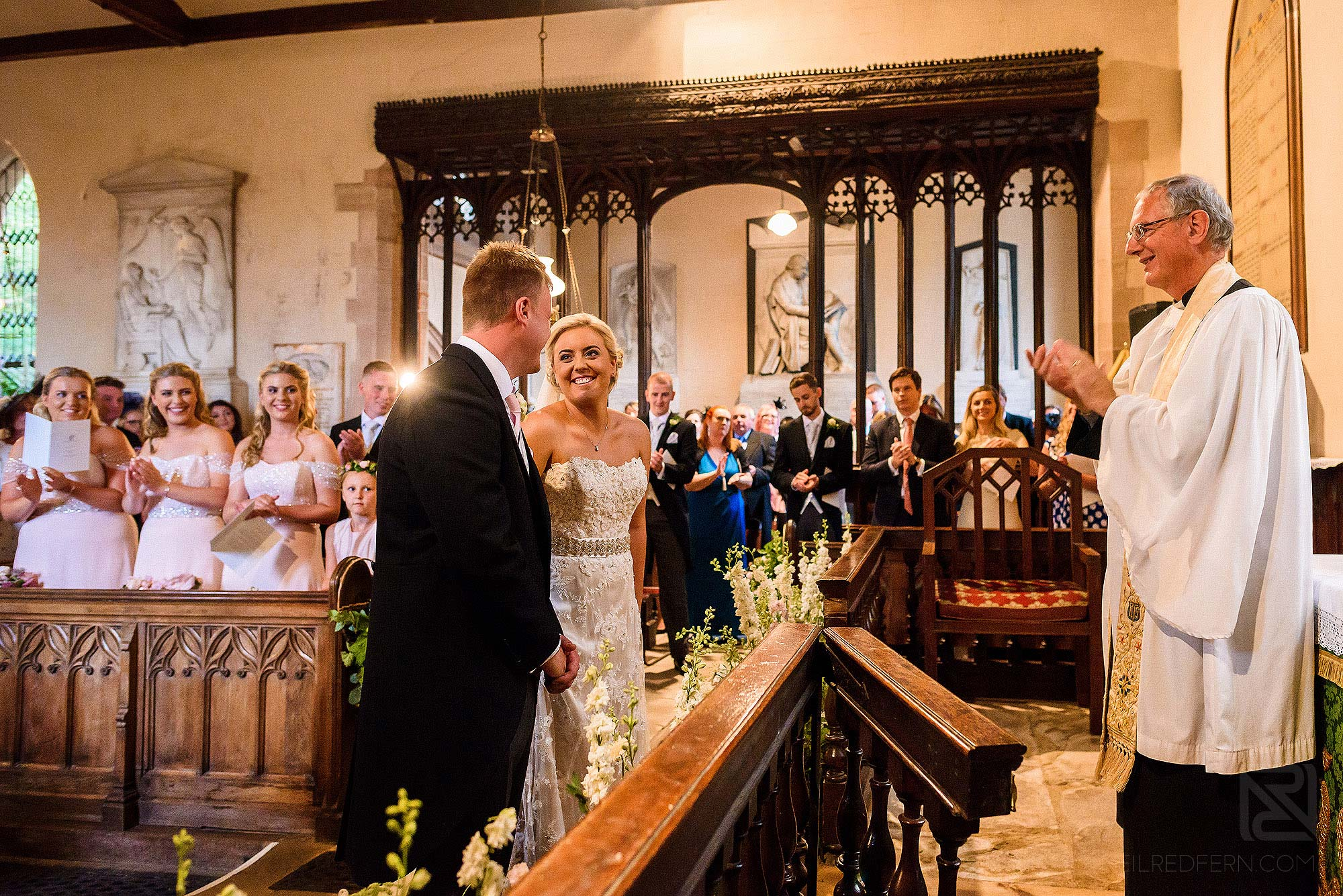 bride and groom laughing during church wedding ceremony