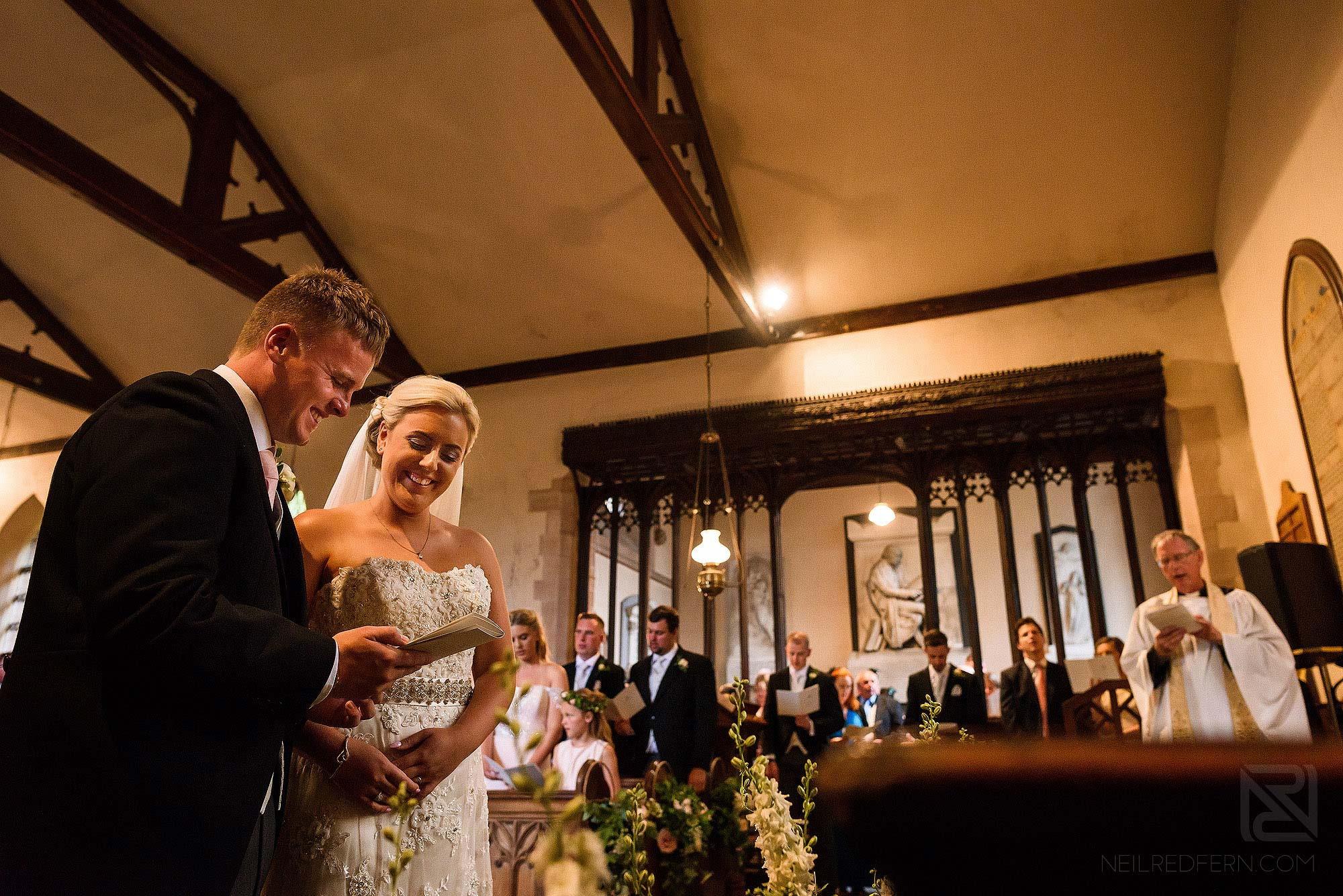 newlyweds smiling during wedding ceremony in Church