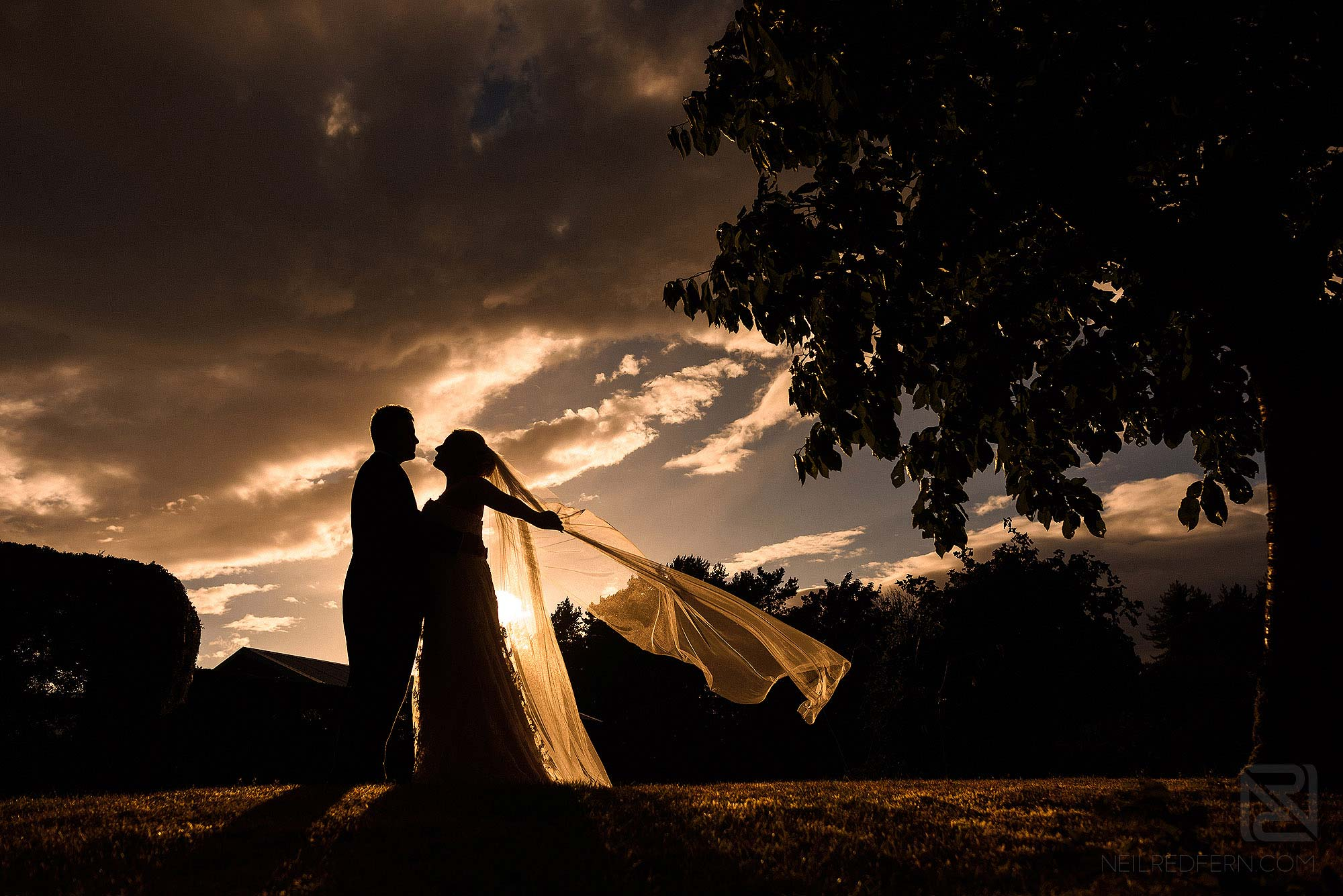 silhouette photograph of newly wed couple at DIY wedding in the countryside