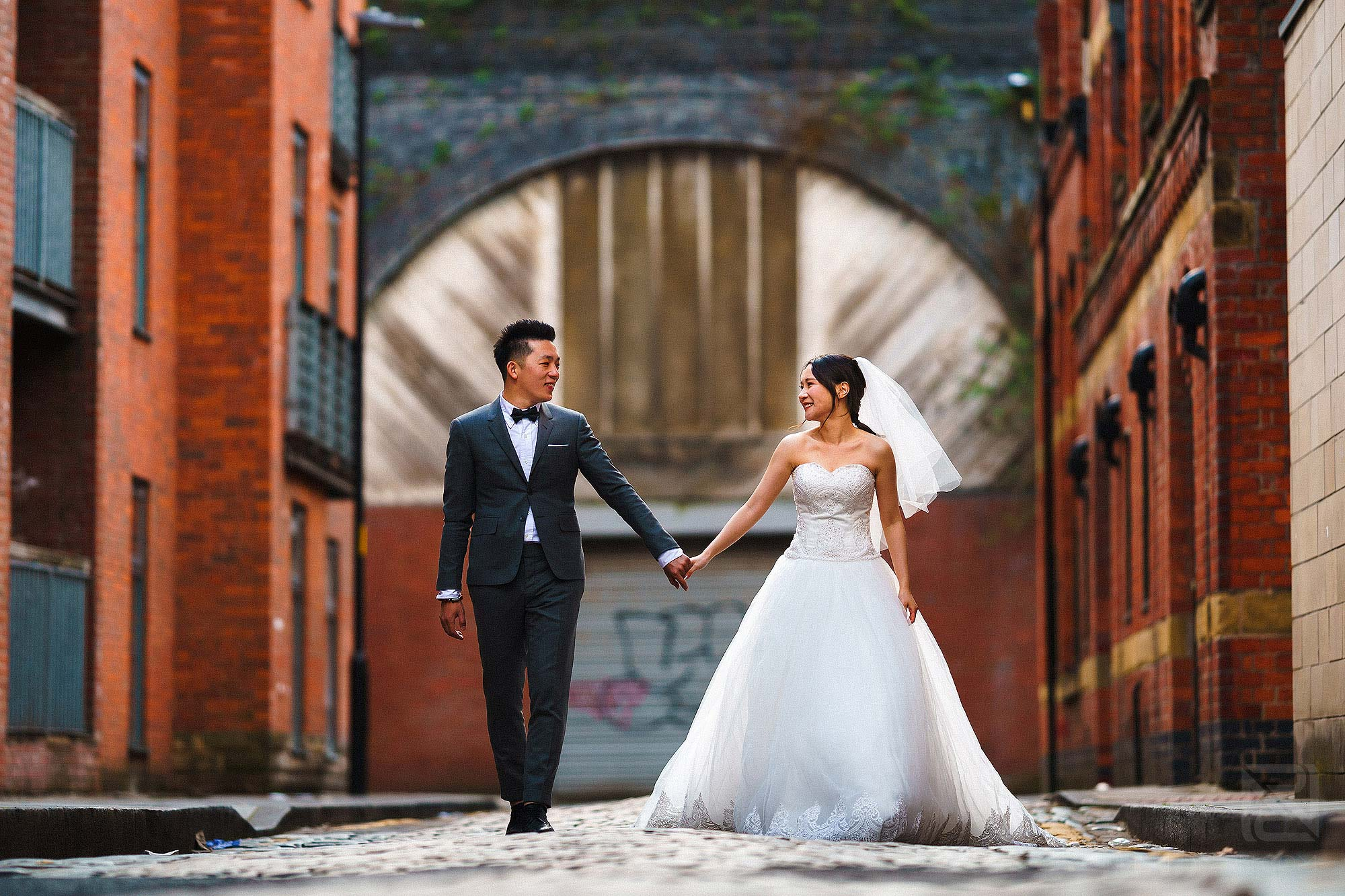 bride and groom holding hands during pre-wedding shoot