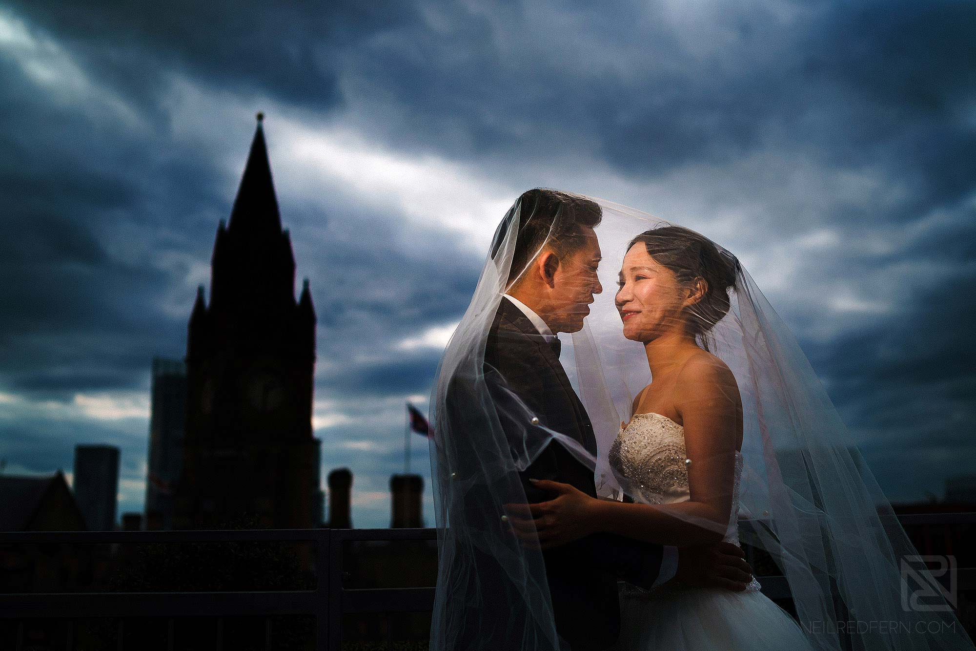 bride and groom portrait in front of Manchester Town Hall