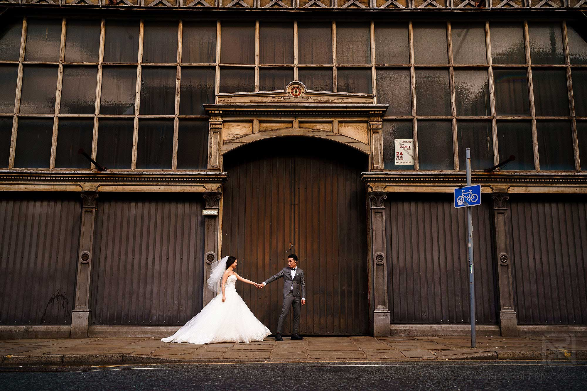 bride and groom outside Museum of Science and Industry in Manchester