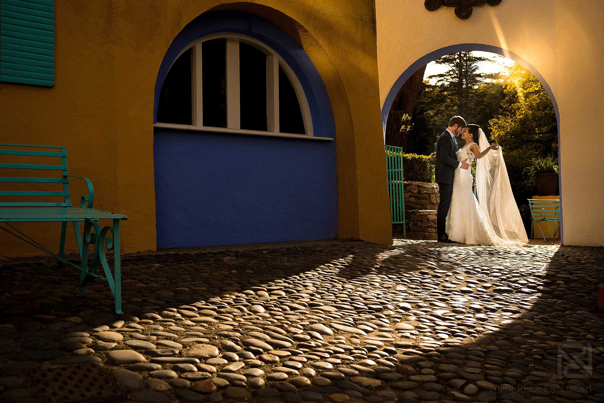 bride and groom at sunset in Portmeirion Village