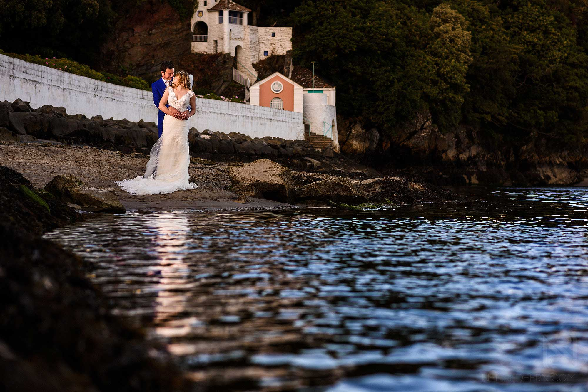 bride and groom on beach at Portmeirion