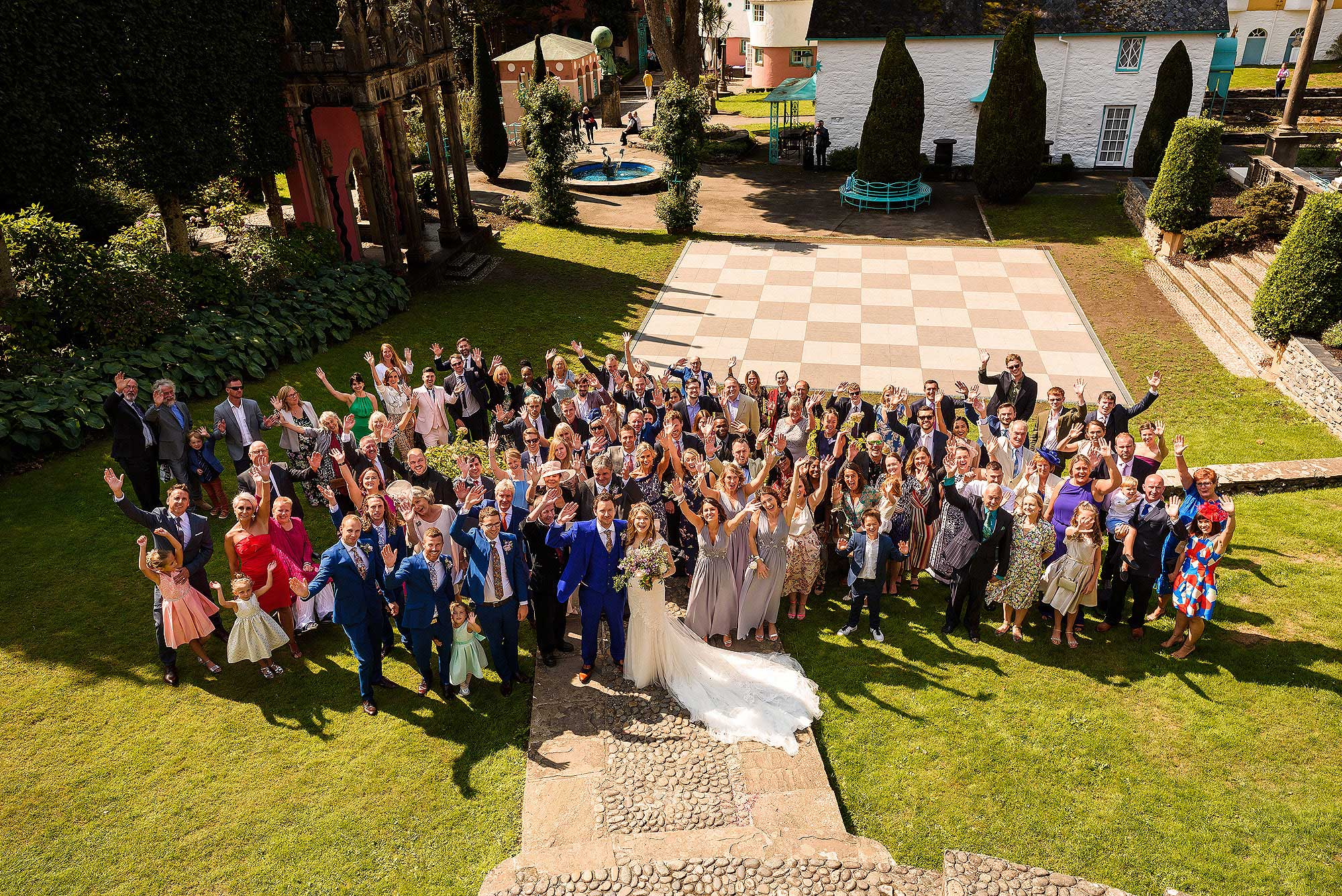 group photograph of all wedding guests in Portmeirion Village