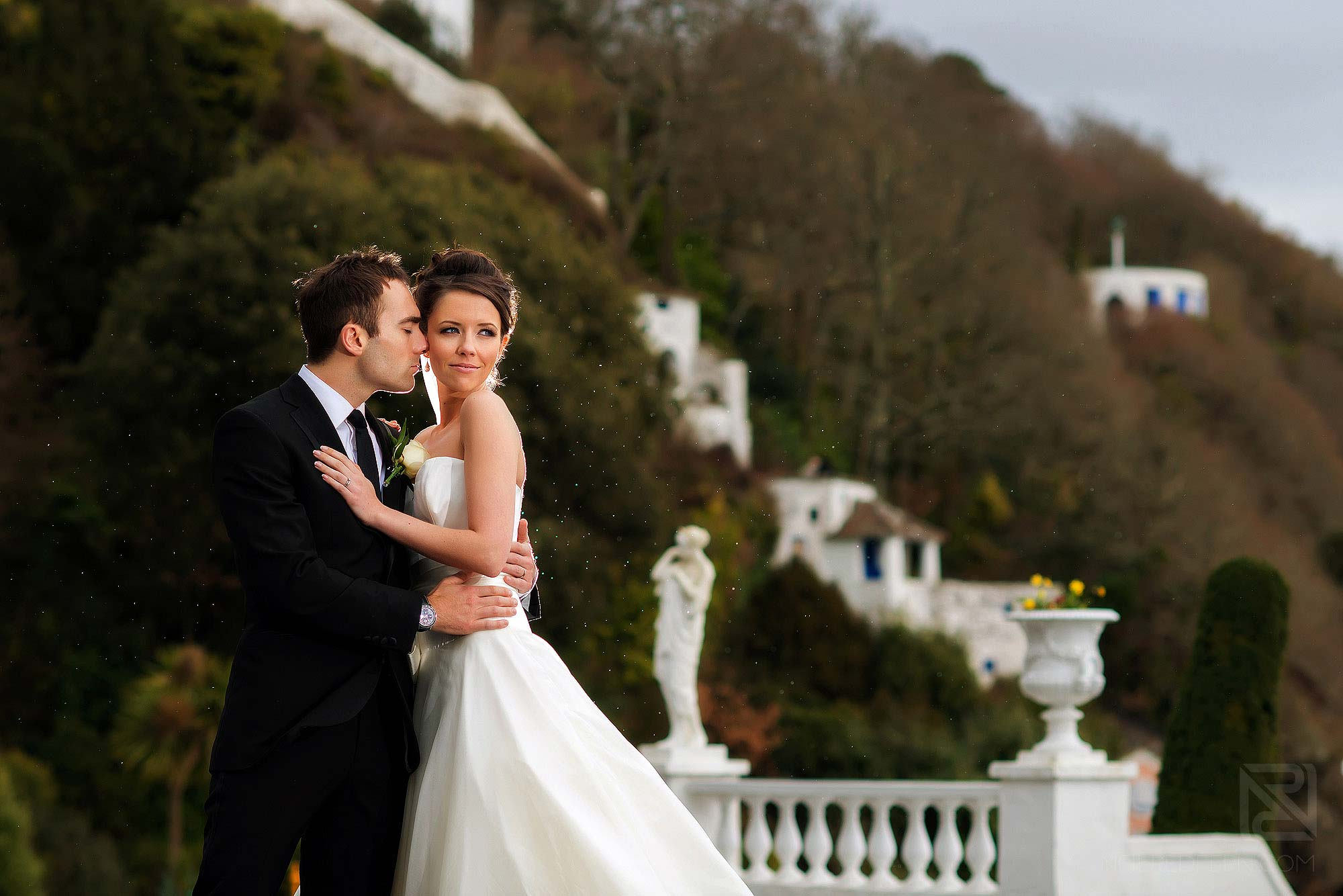 bride and groom in the rain at Portmeirion in Wales