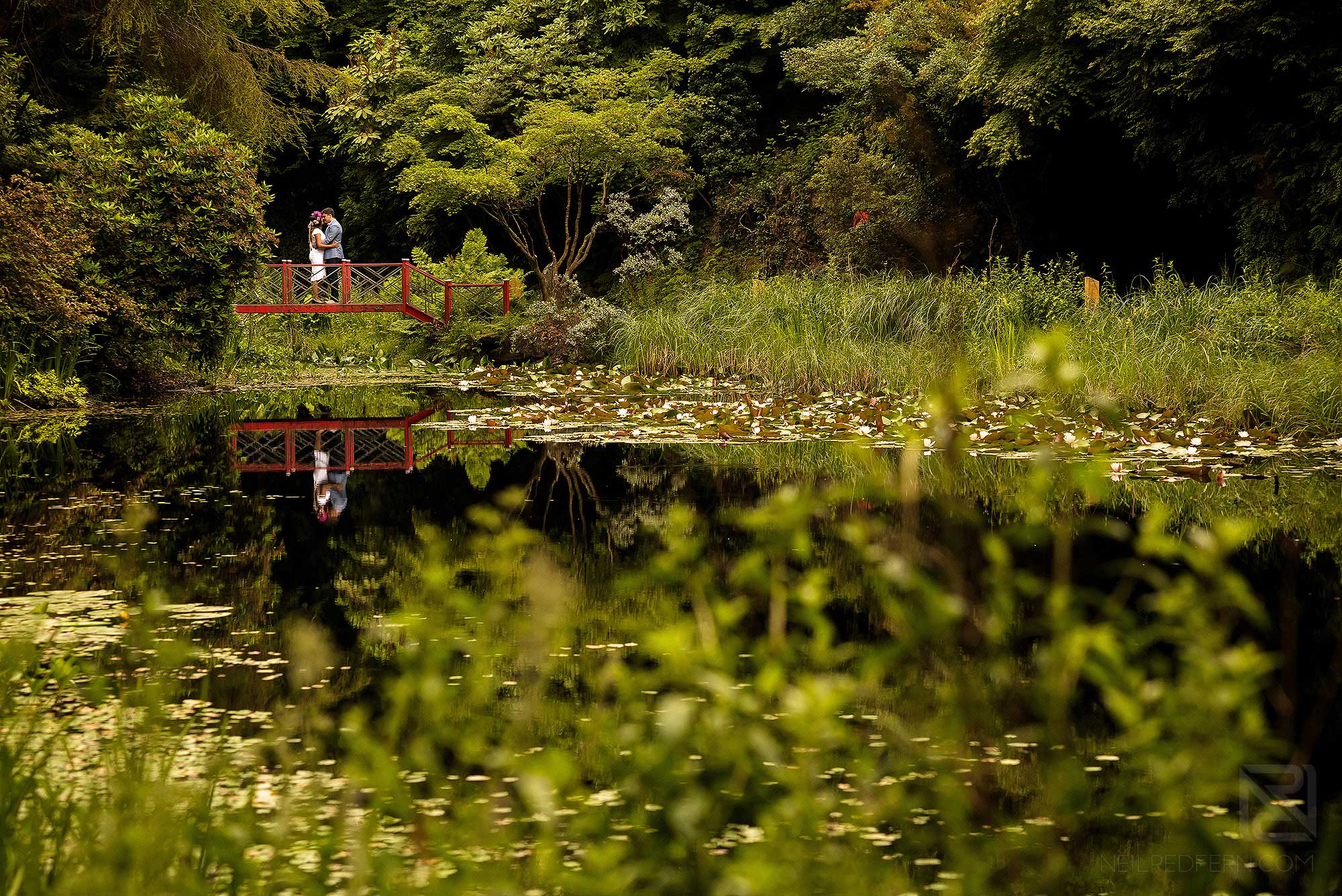 bride and groom in the gardens at Portmeirion