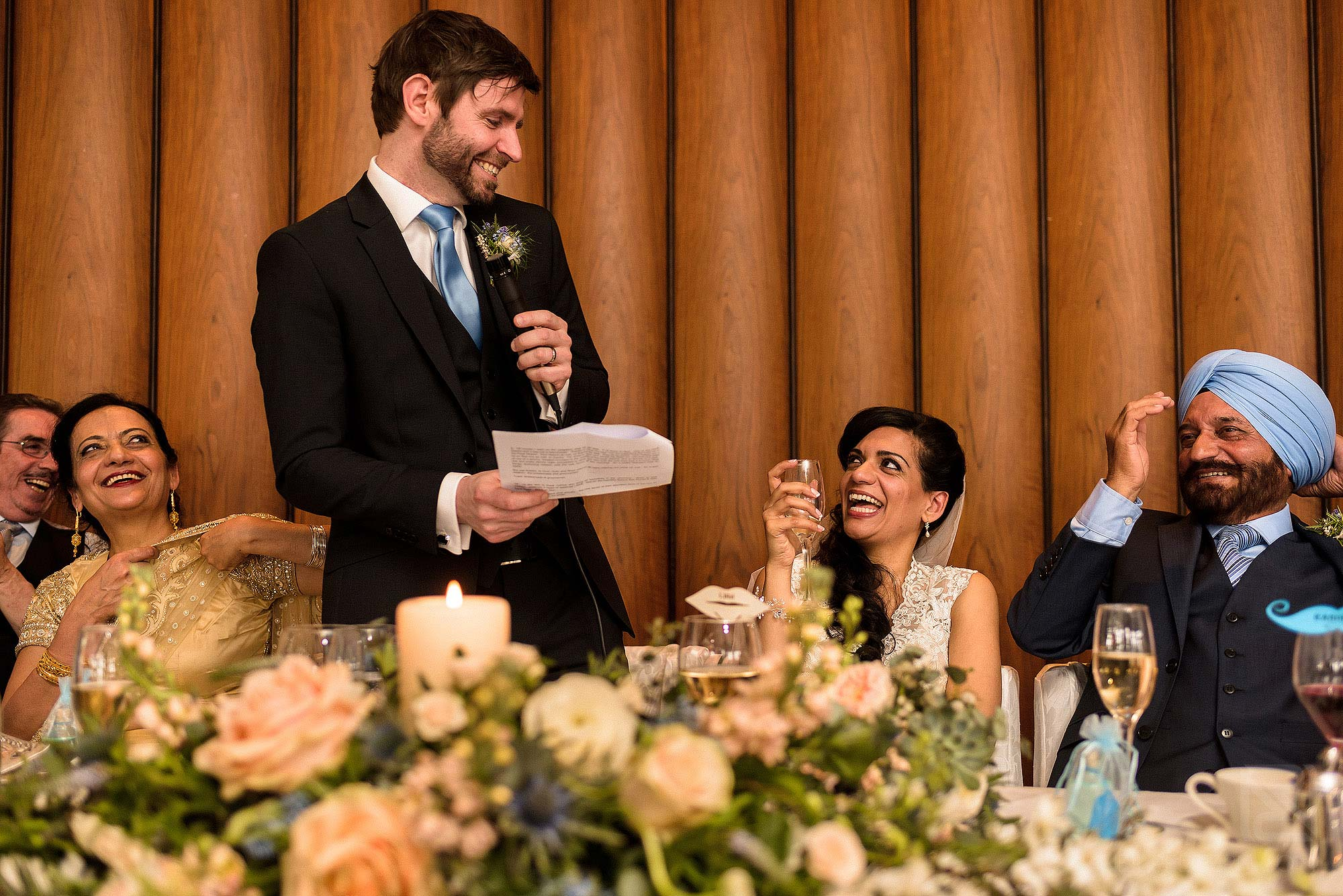 top table laughing during wedding speeches