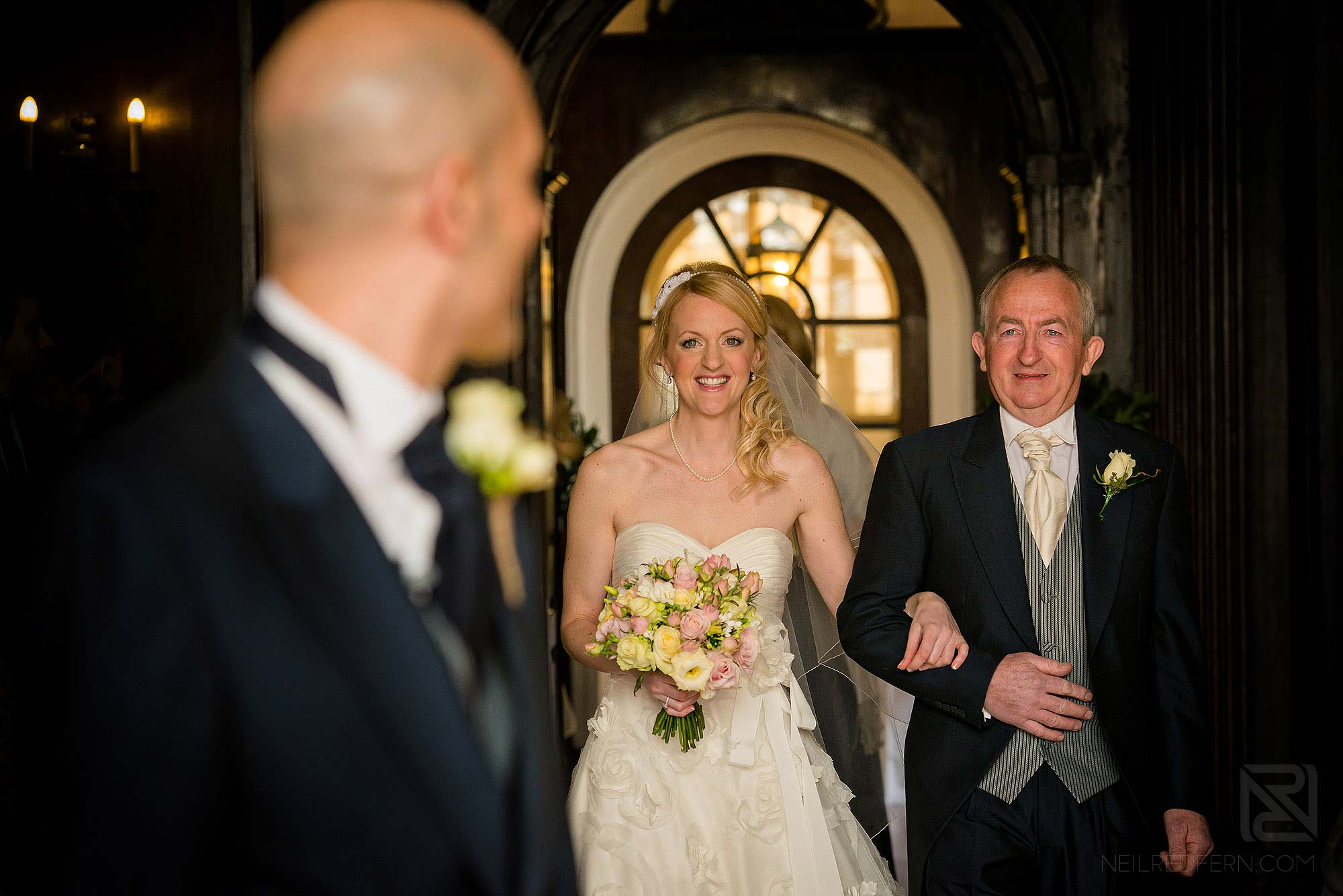 bride and dad walking down the aisle at Portmeirion wedding ceremony