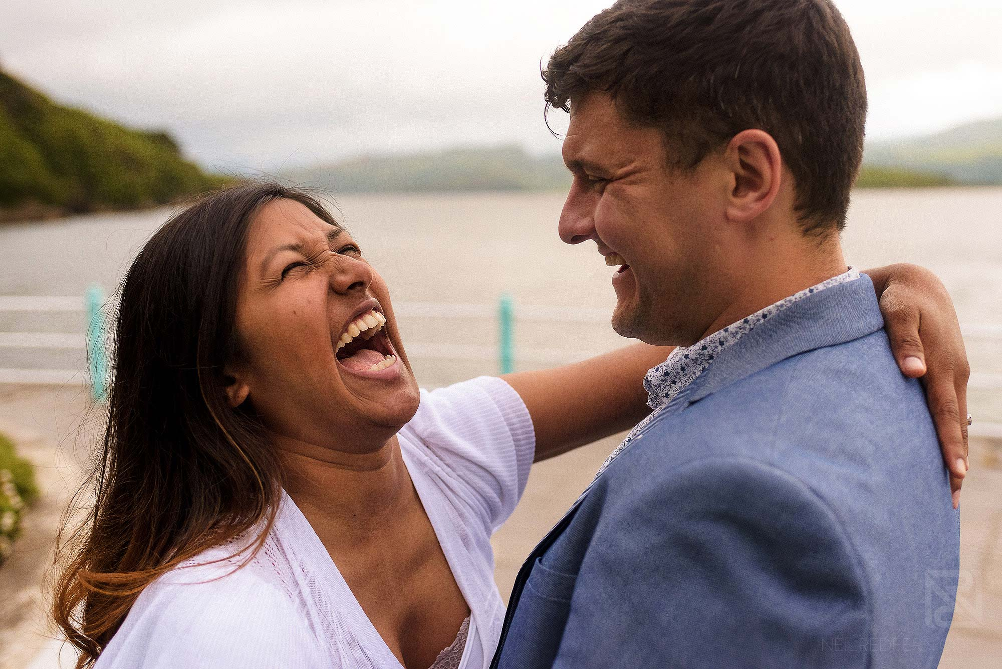 bride and groom laughing together in Portmeirion