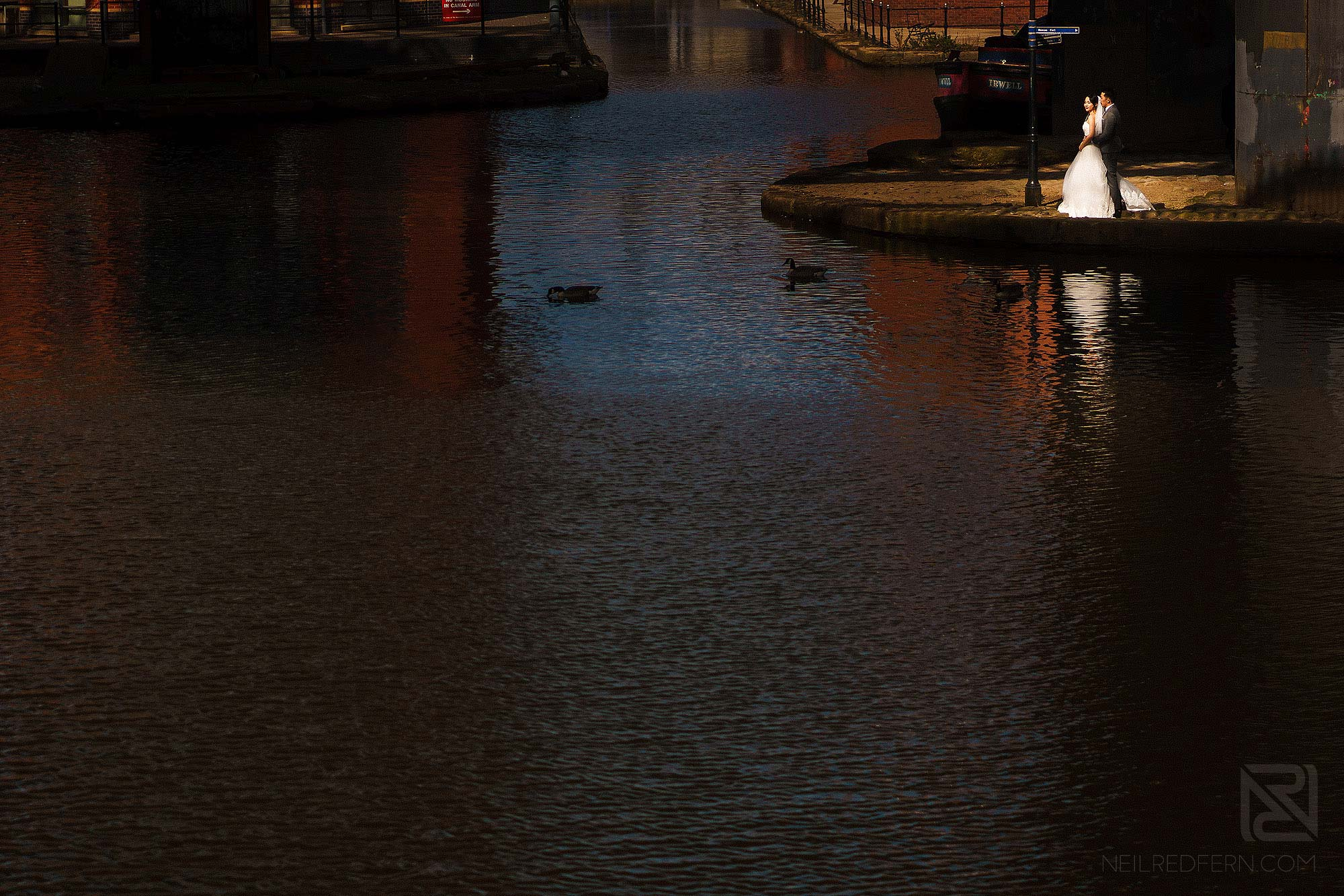 wide angle photograph of bride and groom in Castlefield in Manchester
