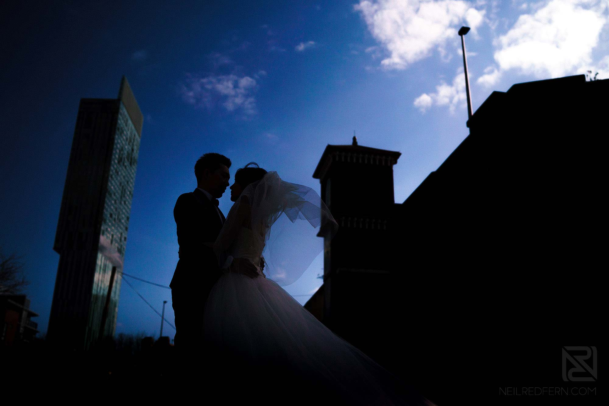 silhouette photograph of bride and groom on pre-wedding shoot