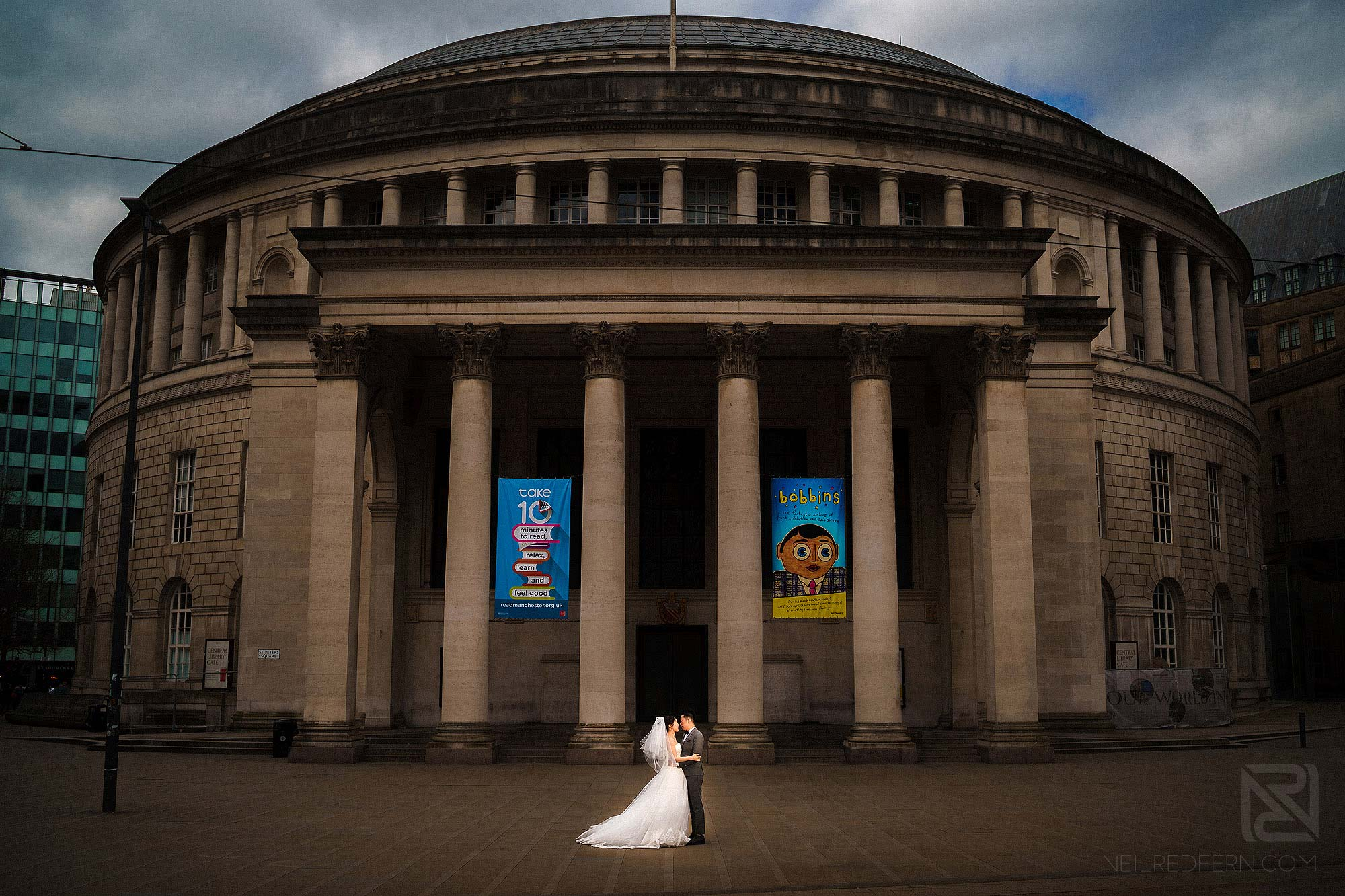 bride and groom outside Central Library in Manchester