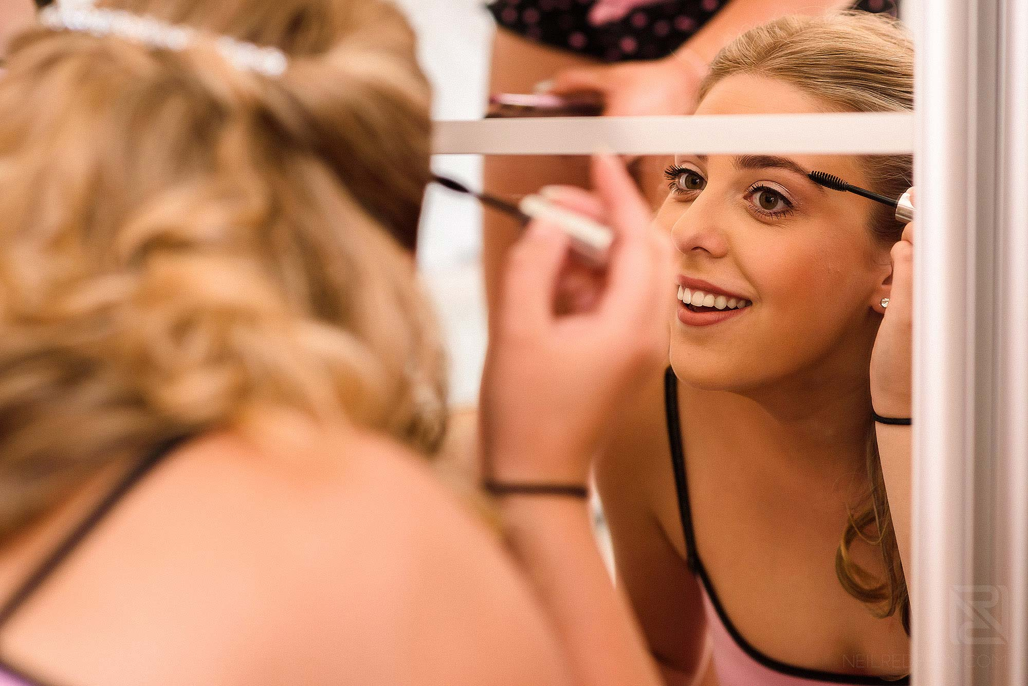 bridesmaid getting ready on morning of wedding