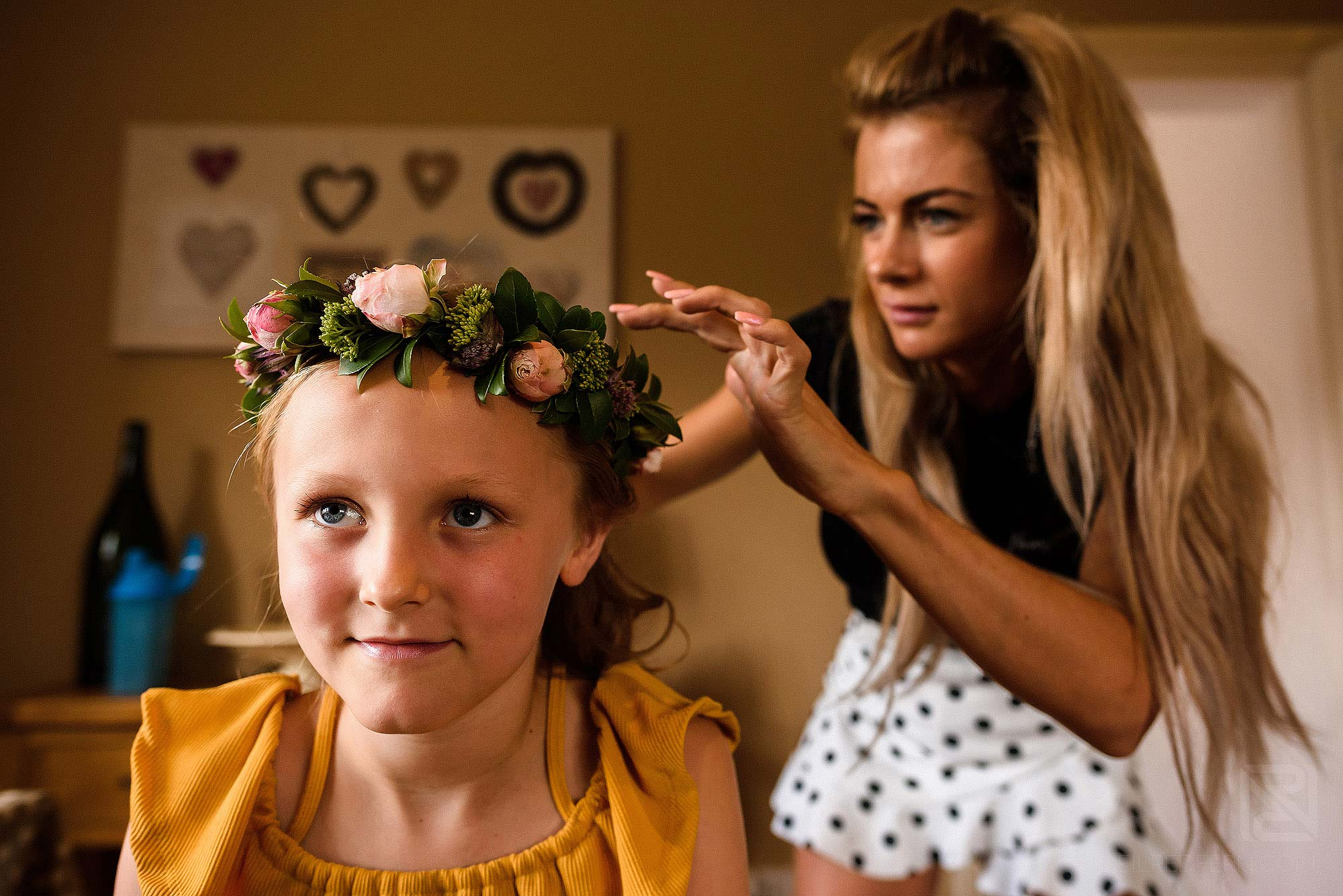 flower girl putting on rustic headpiece