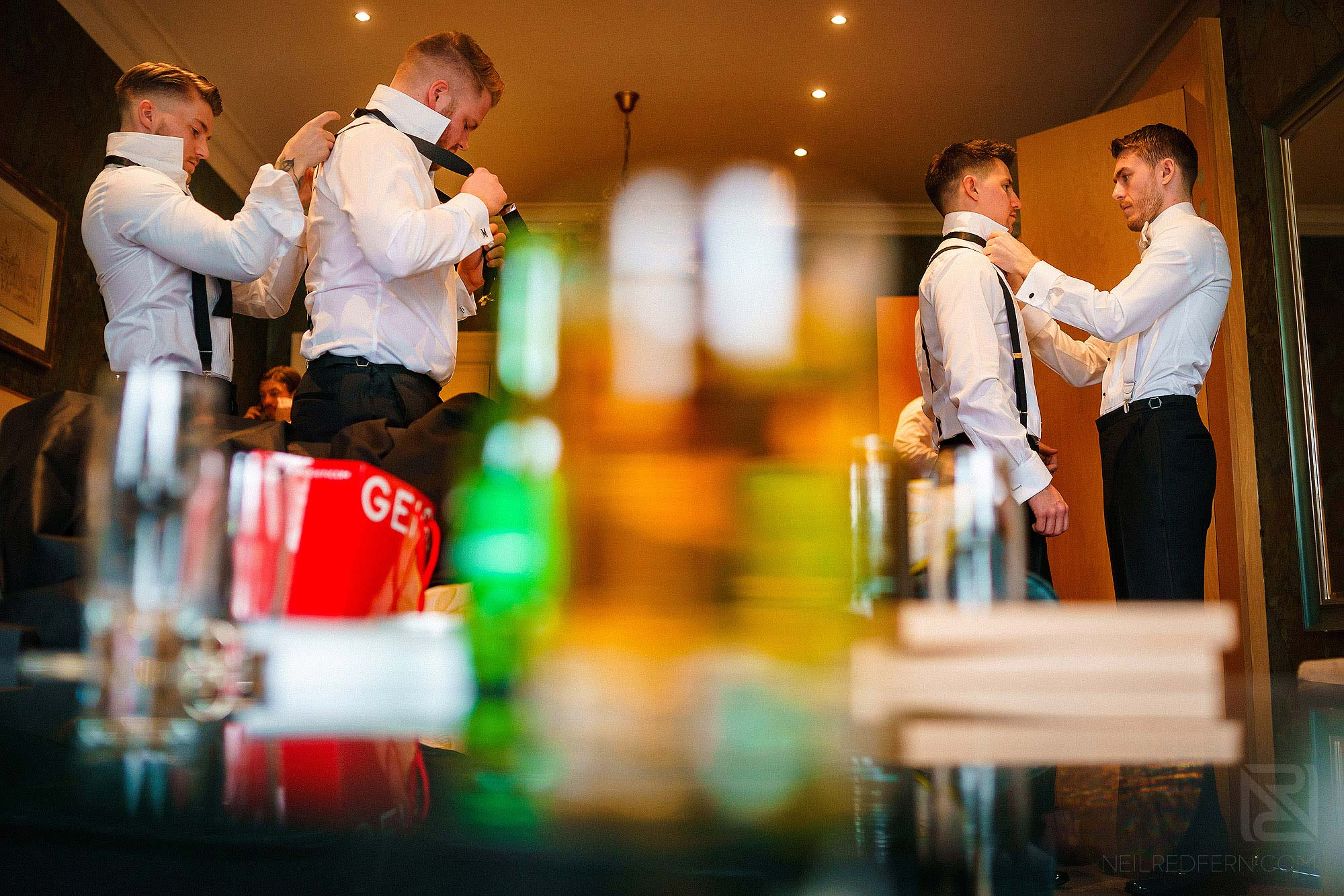 groom and groomsmen getting ready at Eaves Hall