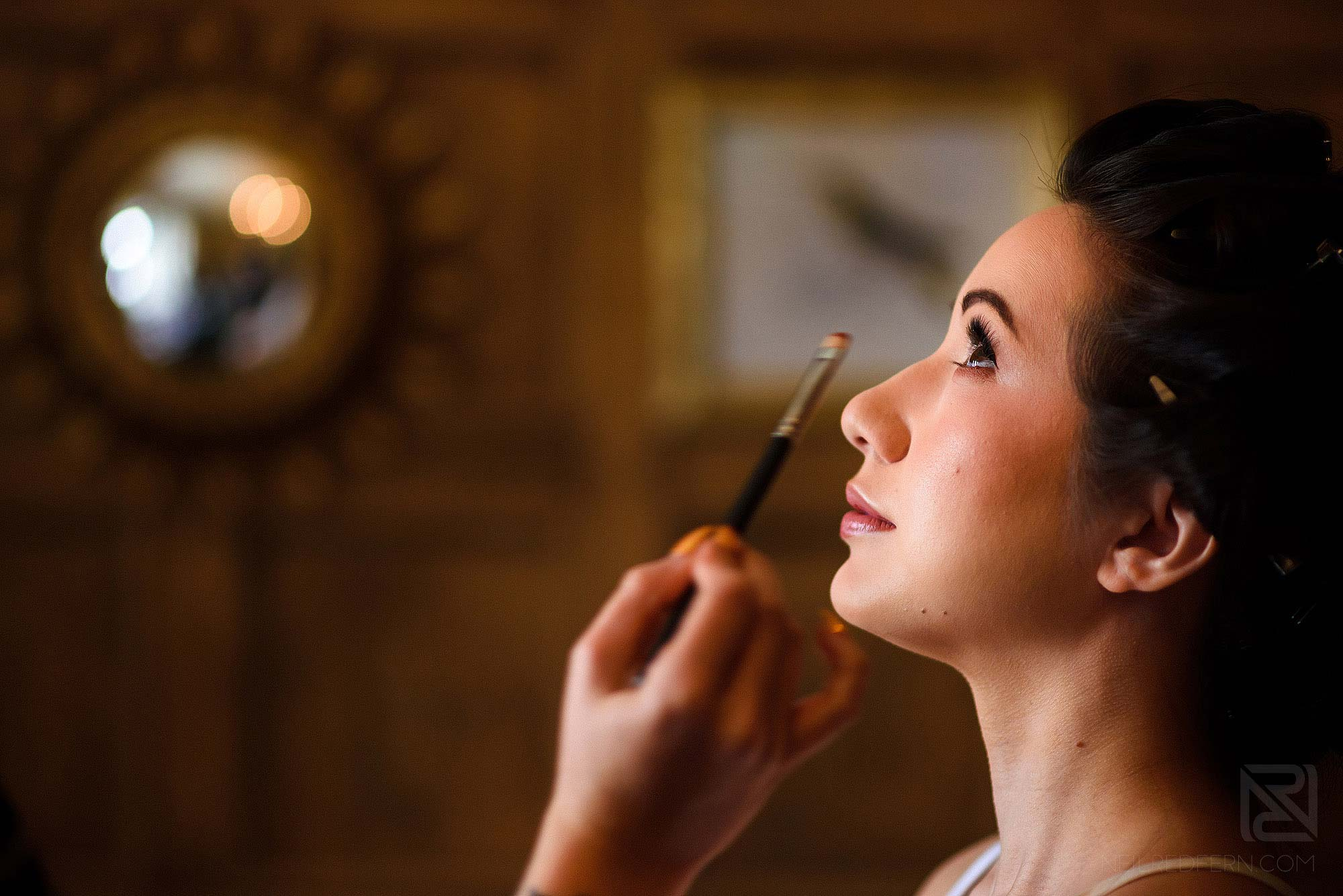 bride getting ready on morning of wedding at Eaves Hall