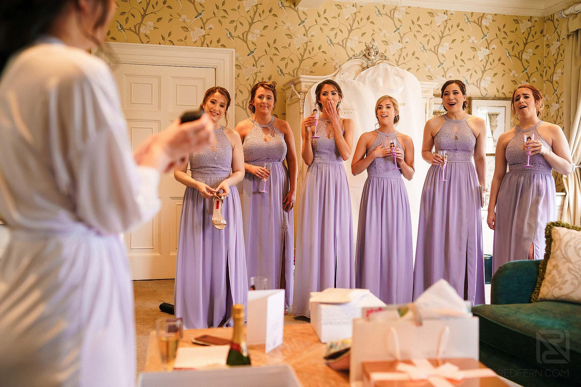 bridesmaids looking at Bride on wedding morning