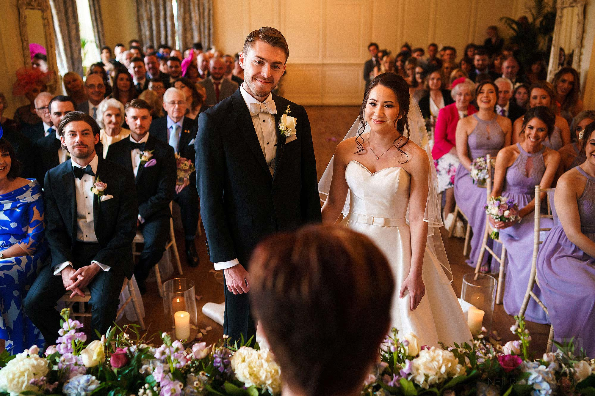 wide angle photograph of wedding ceremony at Eaves Hall