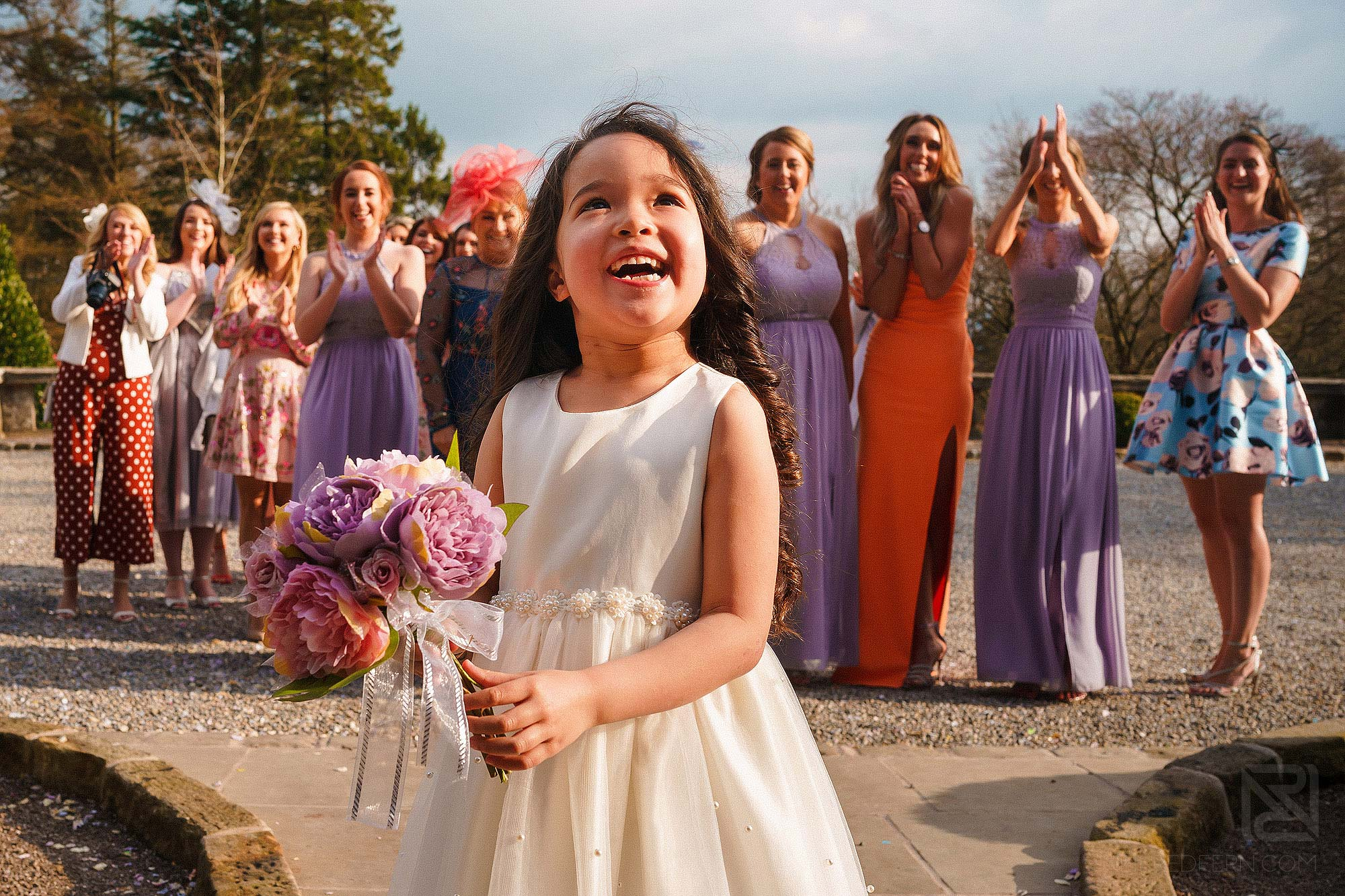 flower girl catching the bouquet