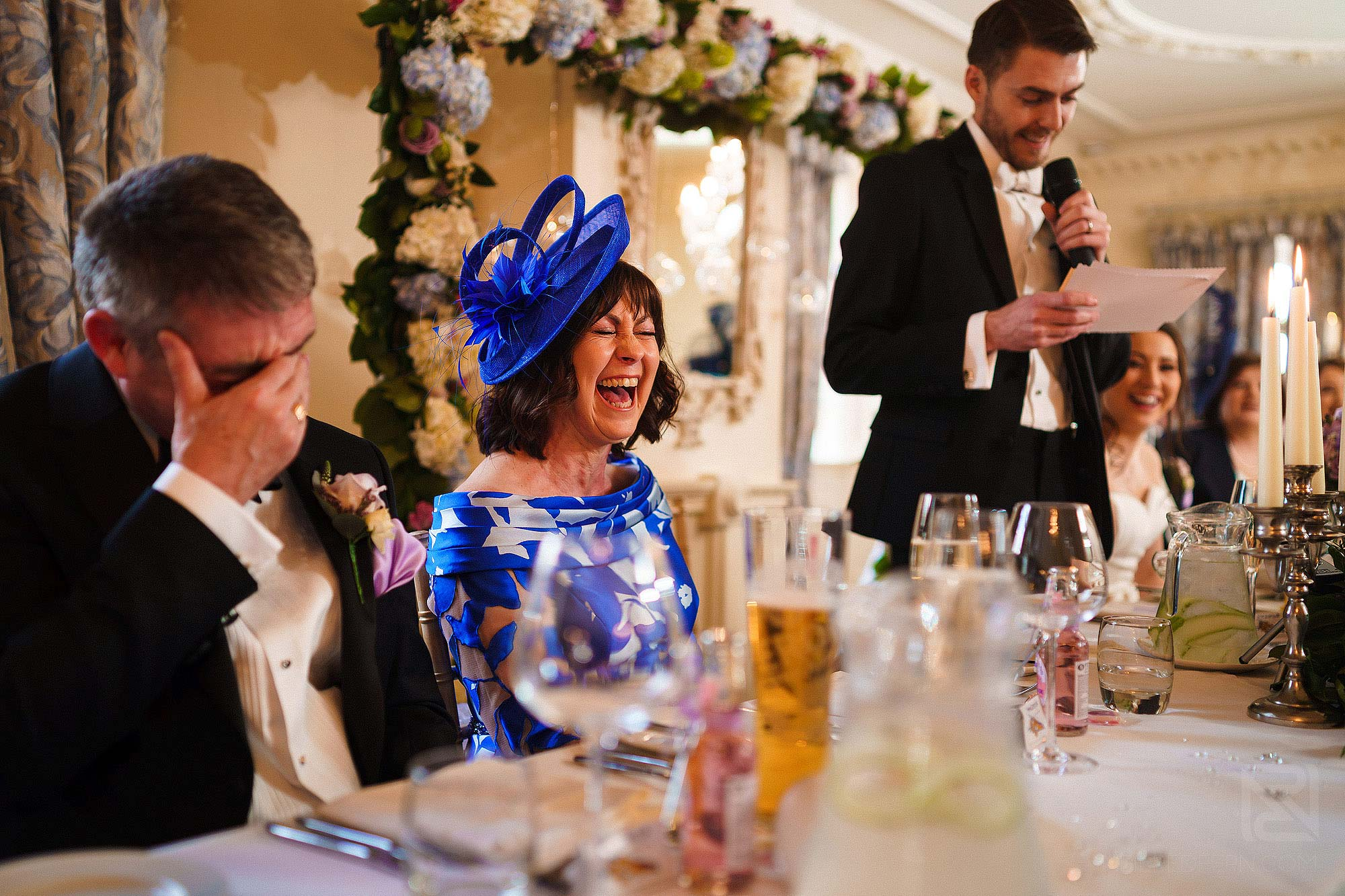 mother of groom laughing during wedding speeches