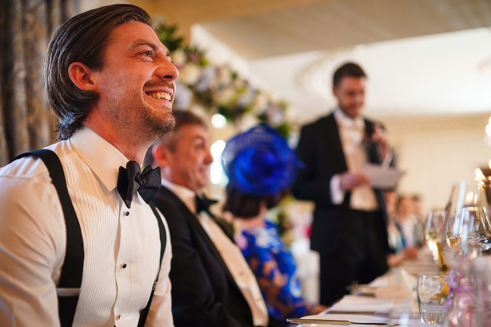 best man laughing during speeches