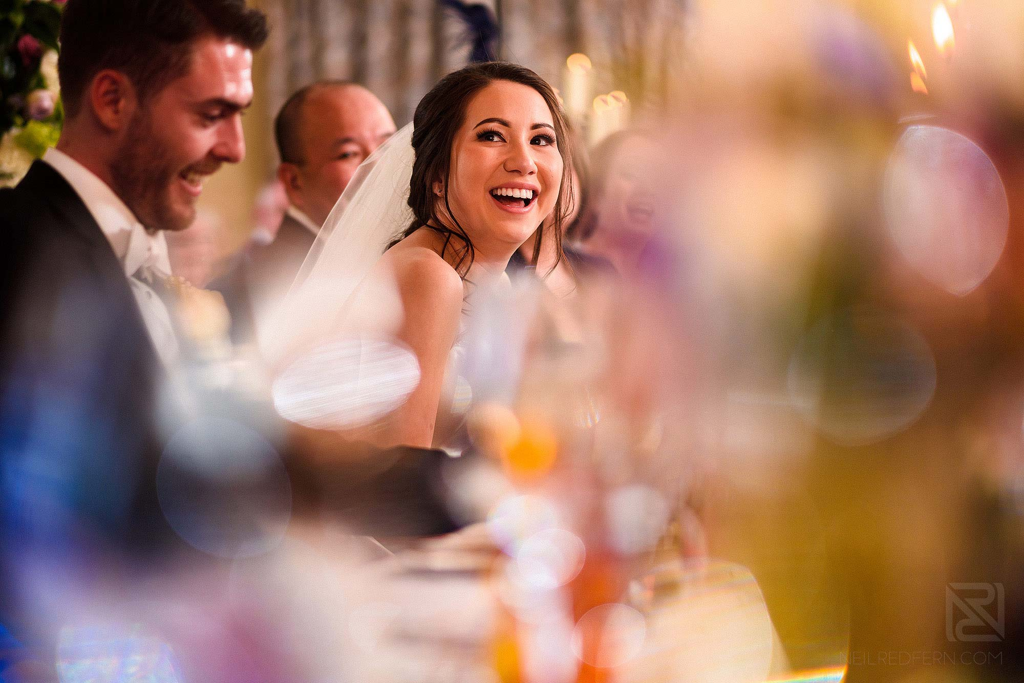happy bride laughing during Best Man's speech