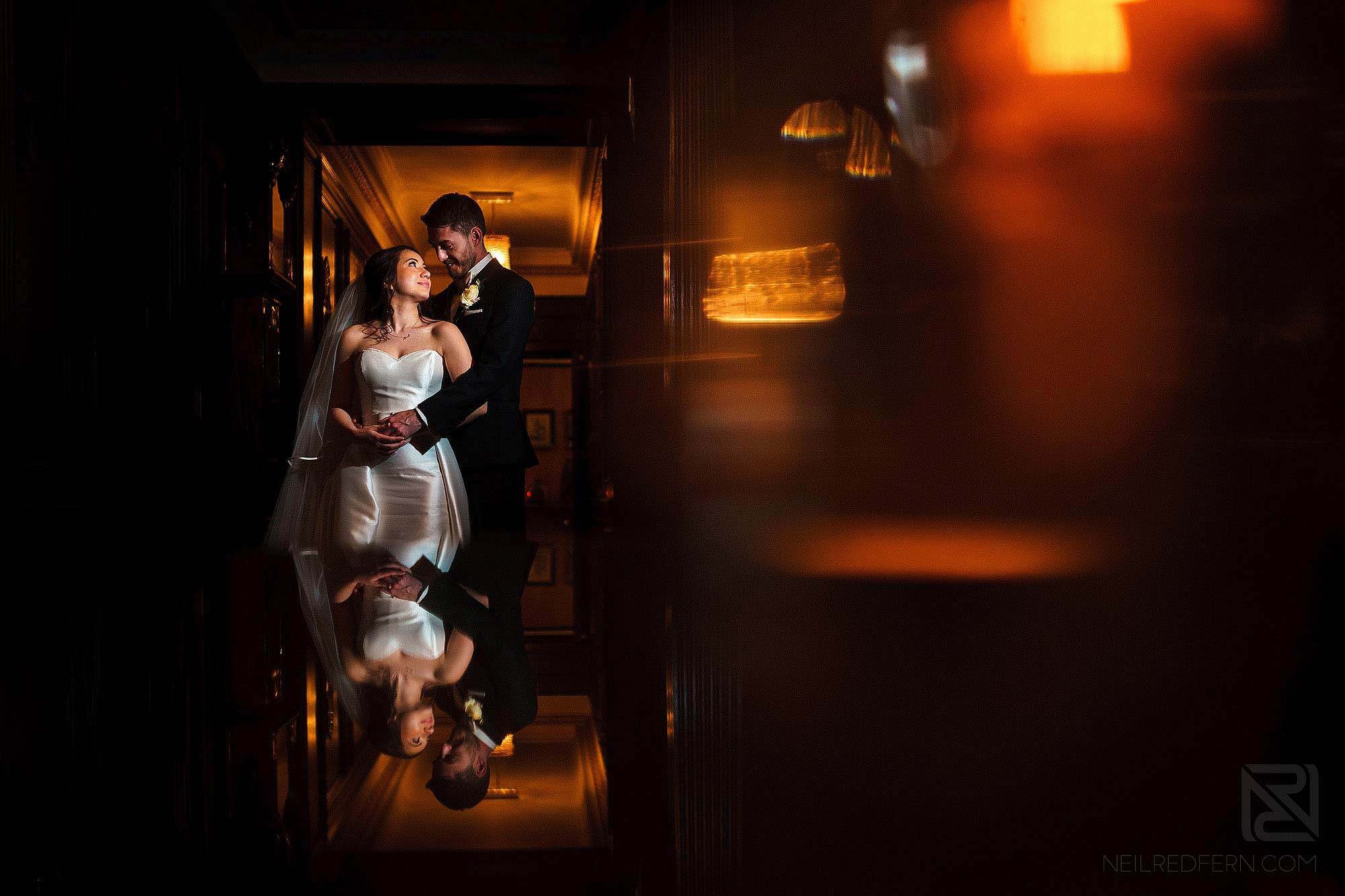 creative indoor off camera flash portrait in Eaves Hall on wedding day