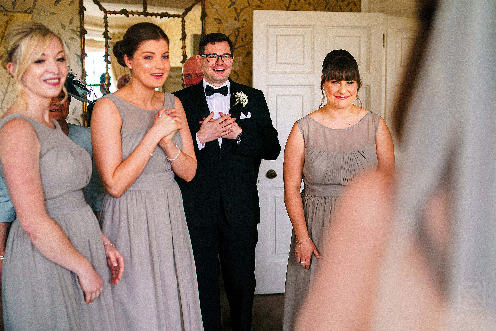 wedding guests looking at bride in dress for first time