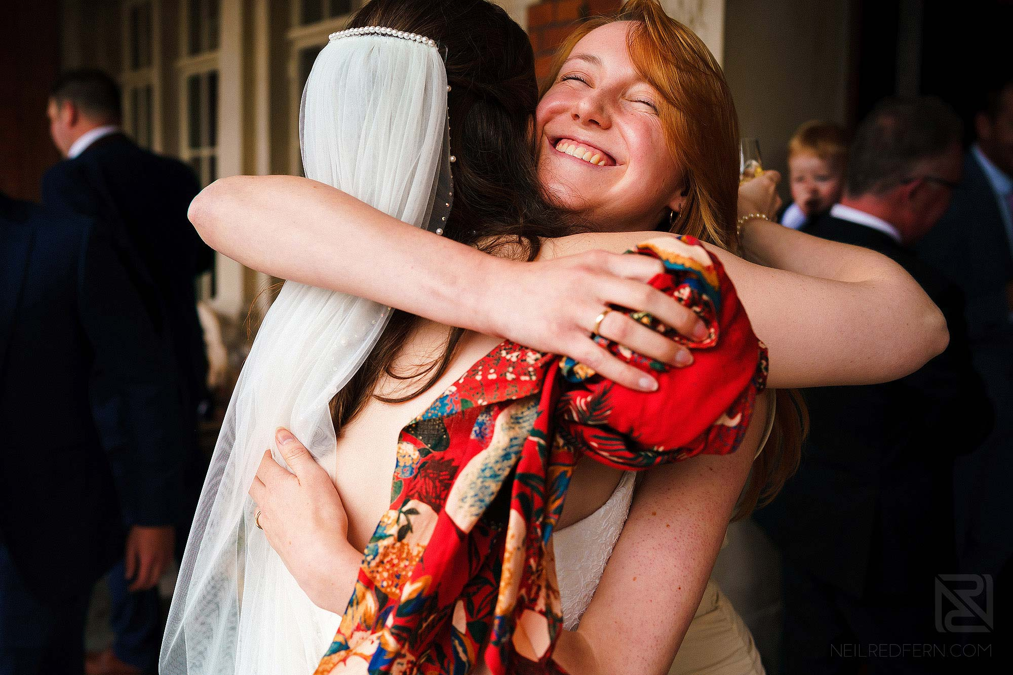 best friend hugging bride during drinks reception